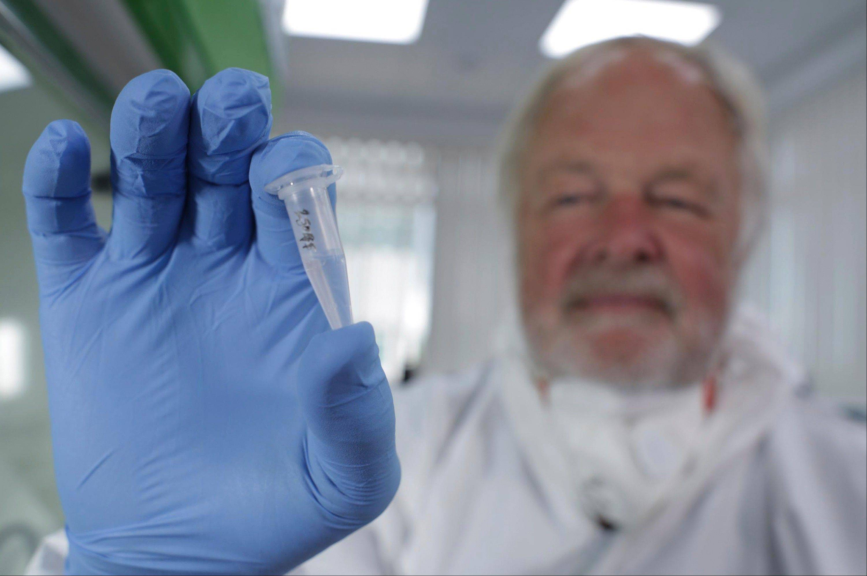 Oxford University genetics professor Bryan Sykes holds a prepared DNA sample taken from the hair of a Himalayan animal that may solve the mystery of the Abominable Snowman -- the elusive ape-like creature also known as the Yeti.