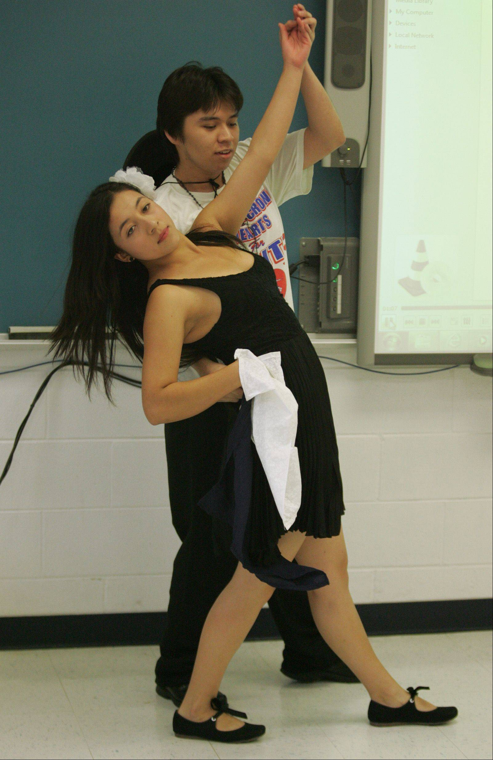 Dundee-Crown seniors Veronica Carrillo and Victor Alvarez rehearse an Argentine dance number Thursday in preparation for the multicultural festival Sunday.