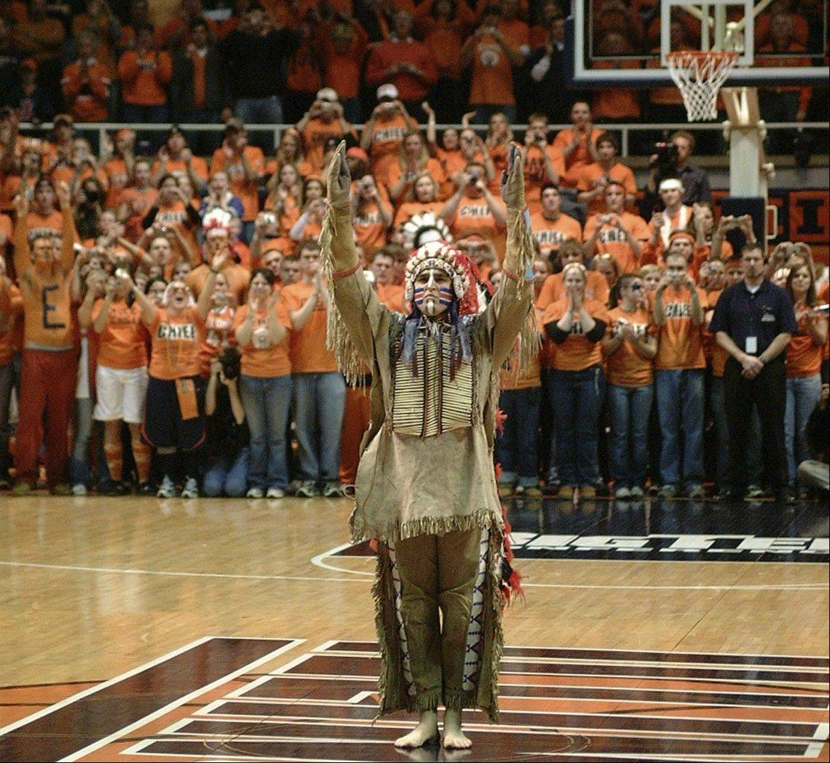 Chief Illiniwek offers one final salute to the crowd gathered at Assembly Hall in Champaign for a basketball game between Illinois and Michigan in 2007.
