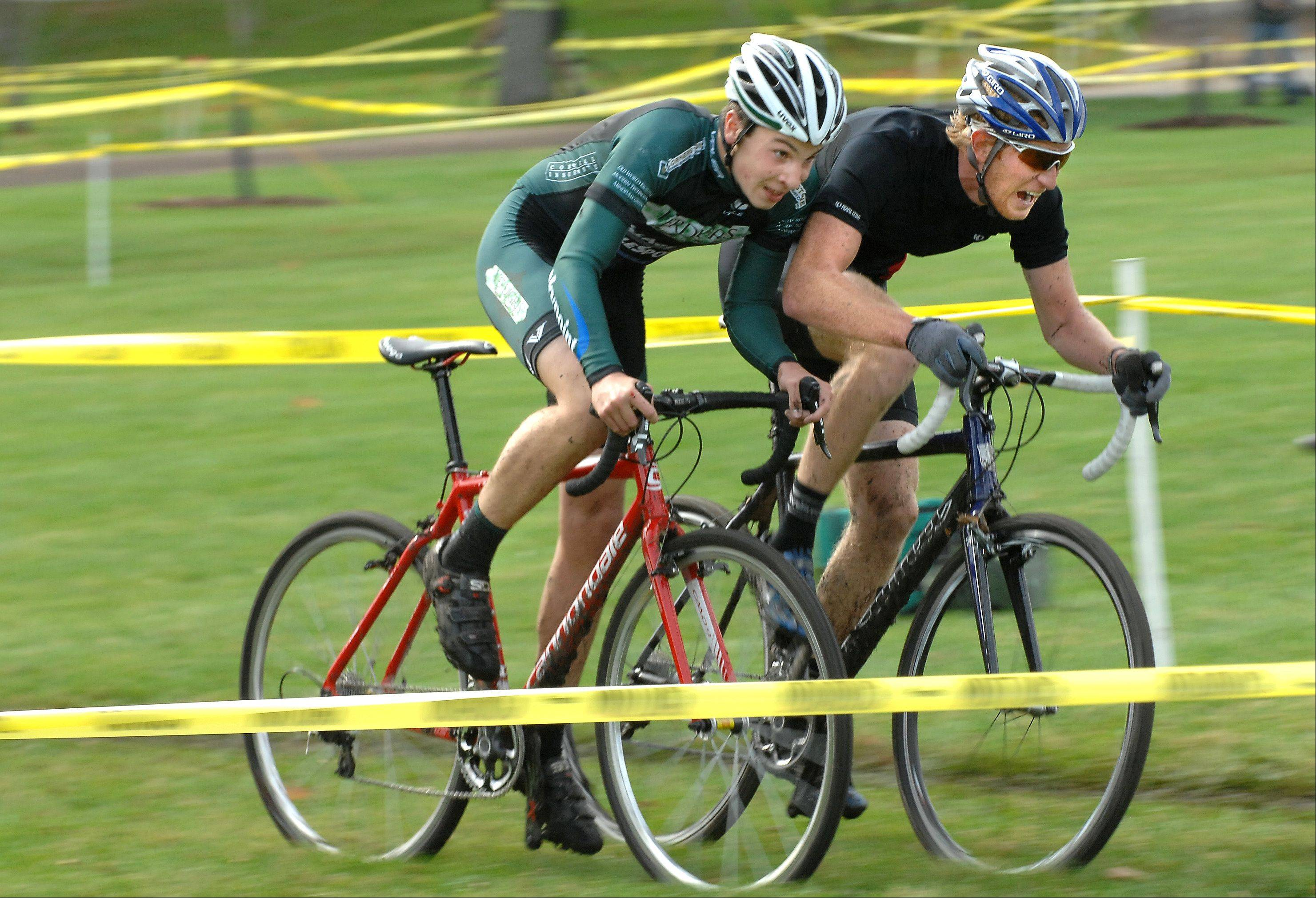 Battling for first place, David Lombardo, left, of Crystal Lake, and Mark Bowers, of Evanston, gasp for air and peddle through the soft grass going into the last turn at the 2011 Chicago Cyclocross Cup men's Category 3 race in Carpenter Park.