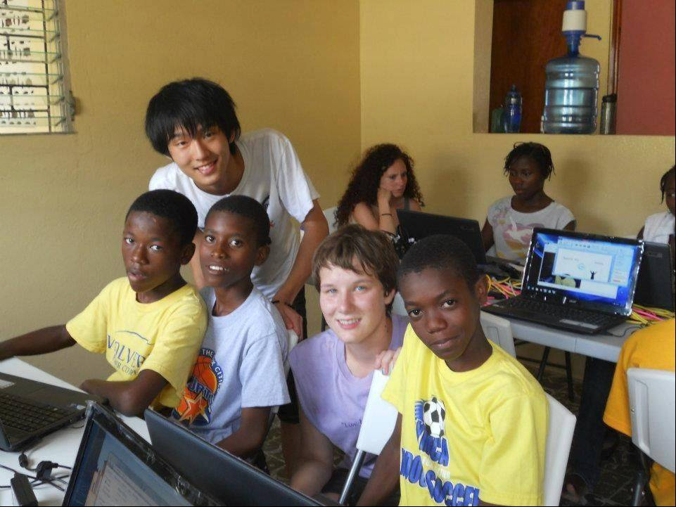Fremd High School graduate Renata Wettermann helps Haitian kids learn how to use computers.