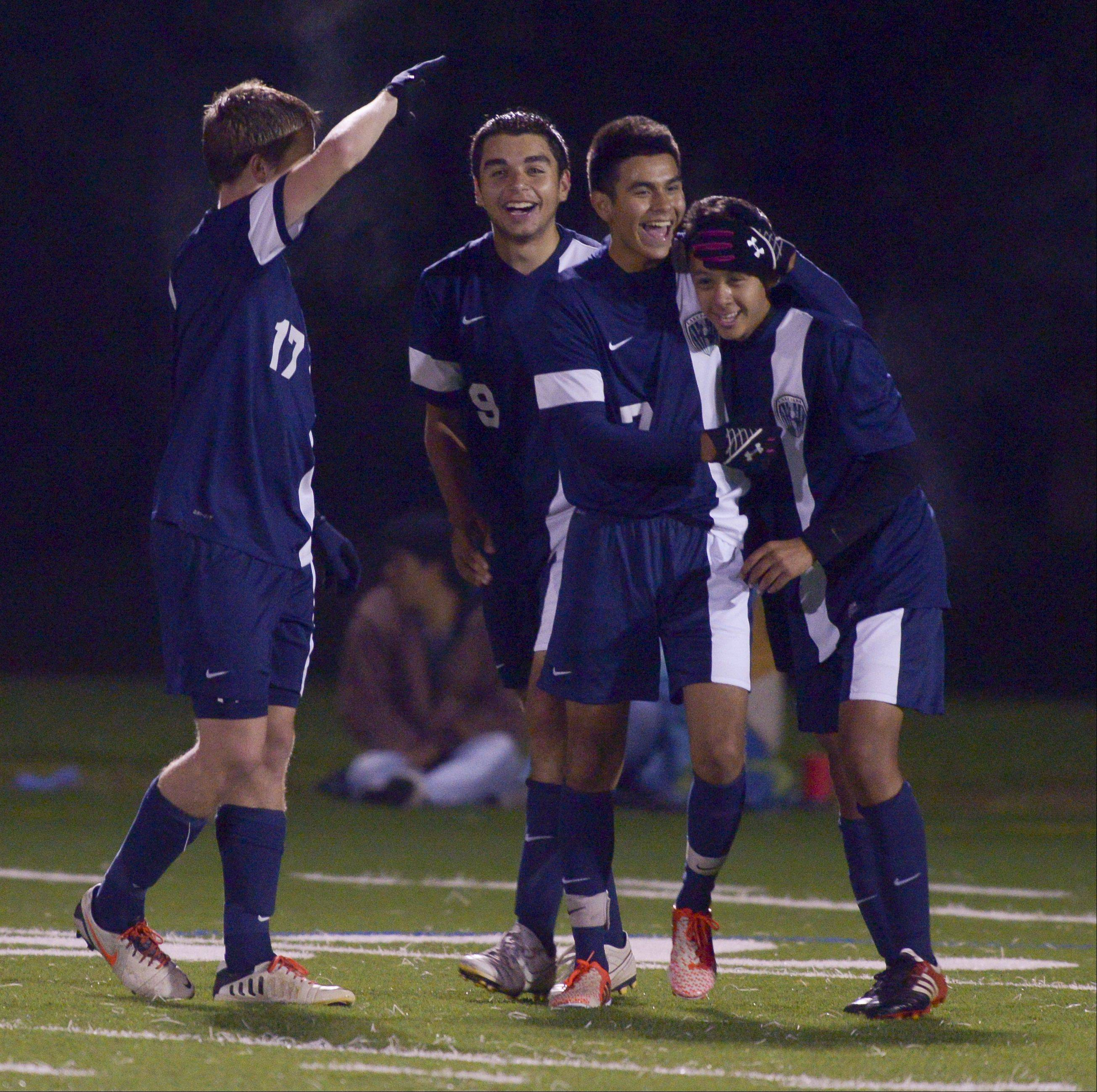 Kris Lopez of Lake Park, right, is congratulated by his teammates after scoring his teams first goal against Fenton during varsity boys soccer in Bensonville, Thursday.
