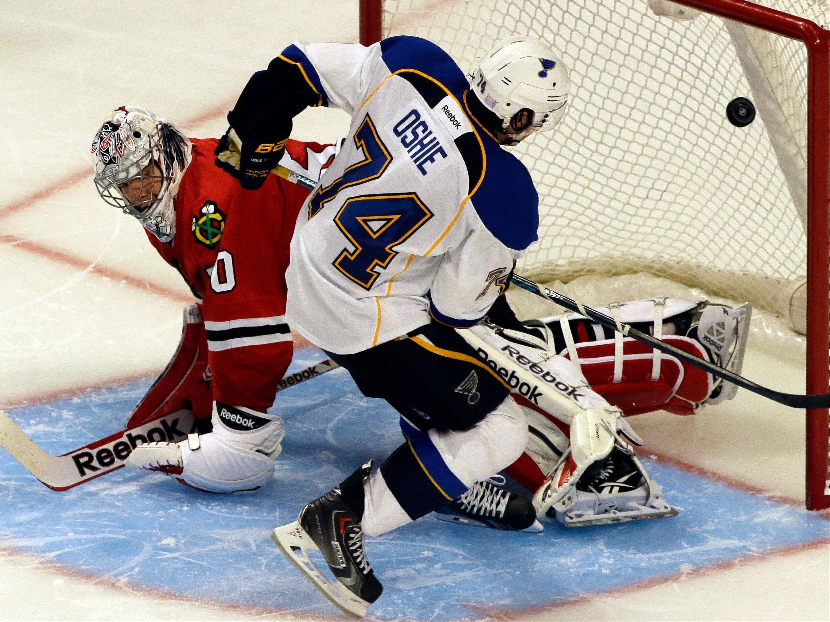 The Blues' T.J. Oshie scores on Blackhawks goalie Corey Crawford for the only goal in the shootout Thursday night at the United Center.