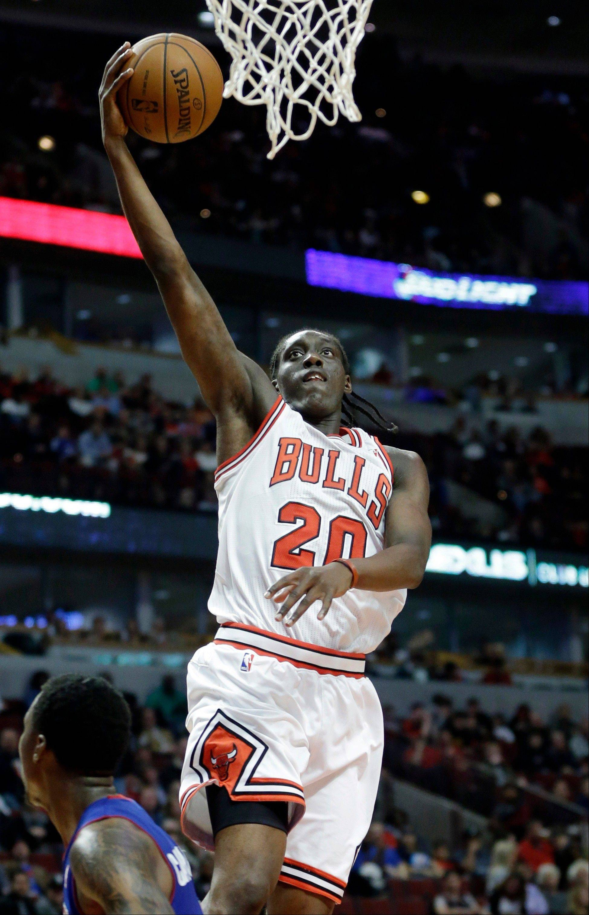 Bulls rookie forward Tony Snell drives to the basket during the second half of an NBA preseason basketball game against the Detroit Pistons in Chicago on Wednesday, Oct. 16, 2013. The Bulls won 96-81.