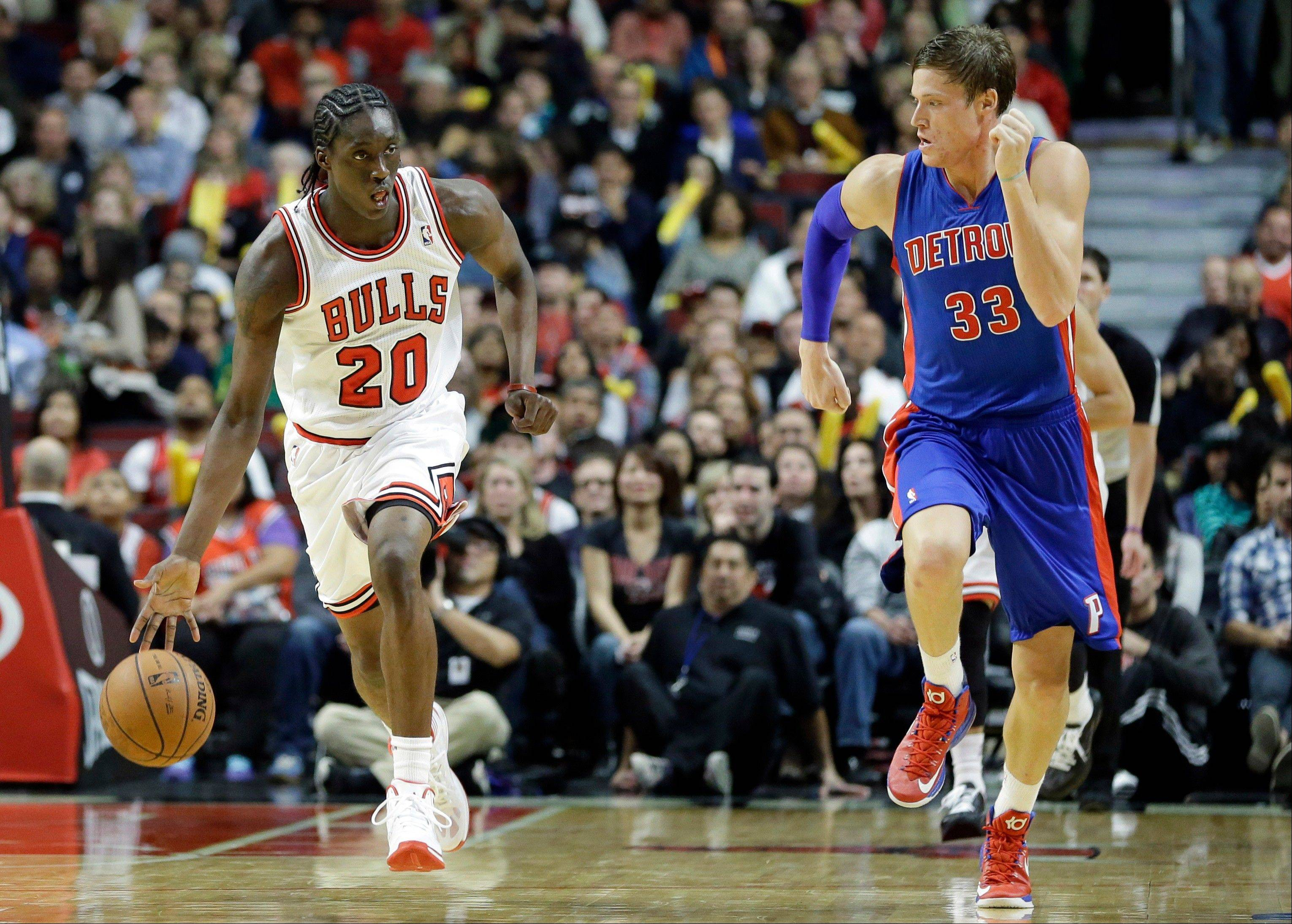 Bulls rookie forward Tony Snell (20) controls the ball against Detroit Pistons forward Jonas Jerebko during the second half of an NBA preseason basketball game in Chicago on Wednesday, Oct. 16, 2013. The Bulls won 96-81.