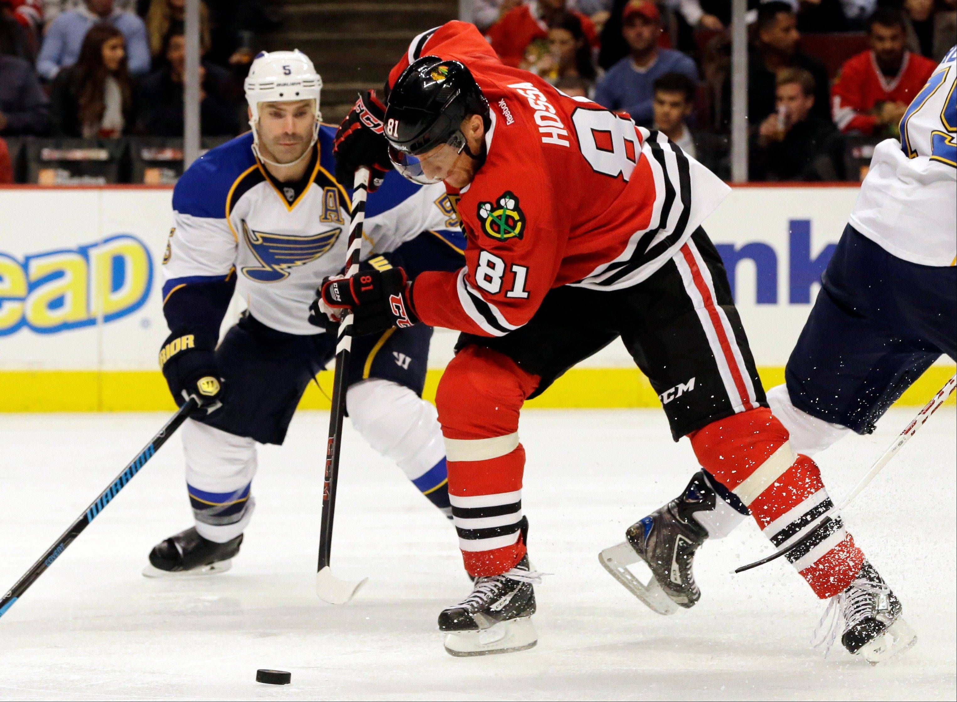 Chicago Blackhawks' Marian Hossa (81) controls the puck during the second period of an NHL hockey game against the St. Louis Blues in Chicago, Thursday, Oct. 17, 2013.