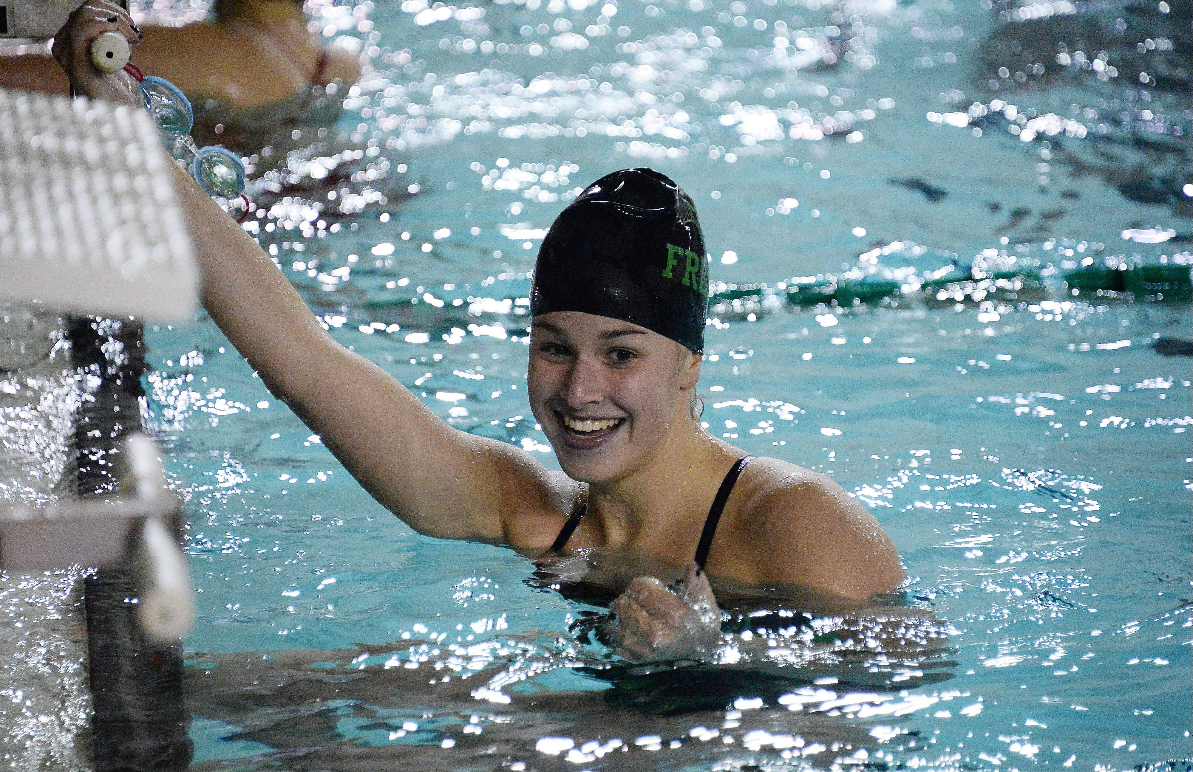 Fremd's Grace Kneller is all smiles after her victory in the 100-meter freestyle against Barrington at Fremd on Thursday.