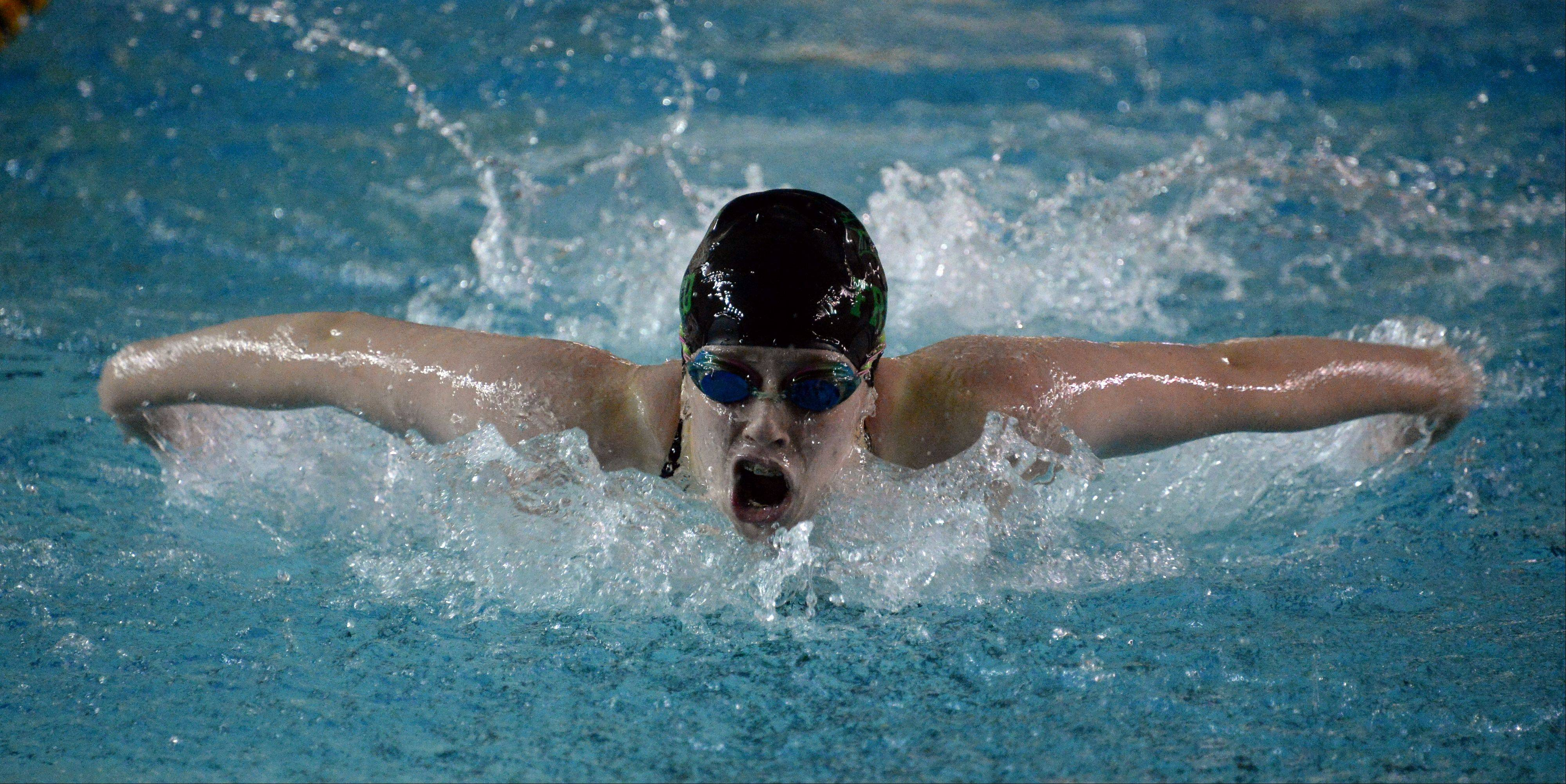 Fremd's Christine Osborn powers her way to victory against Barrington in the 100-meter butterfly at Fremd on Thursday.