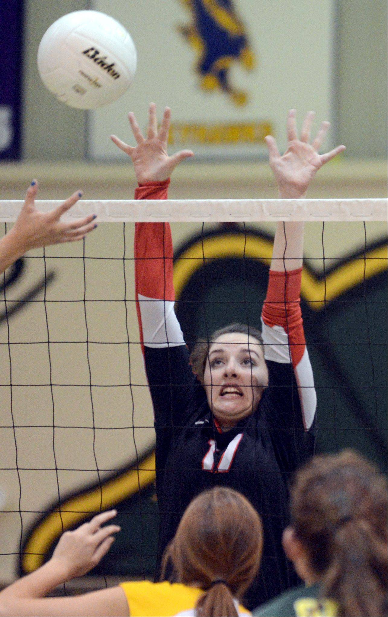 Huntley's Brittney Gundlach blocks the ball at Crystal Lake South on Thursday night.