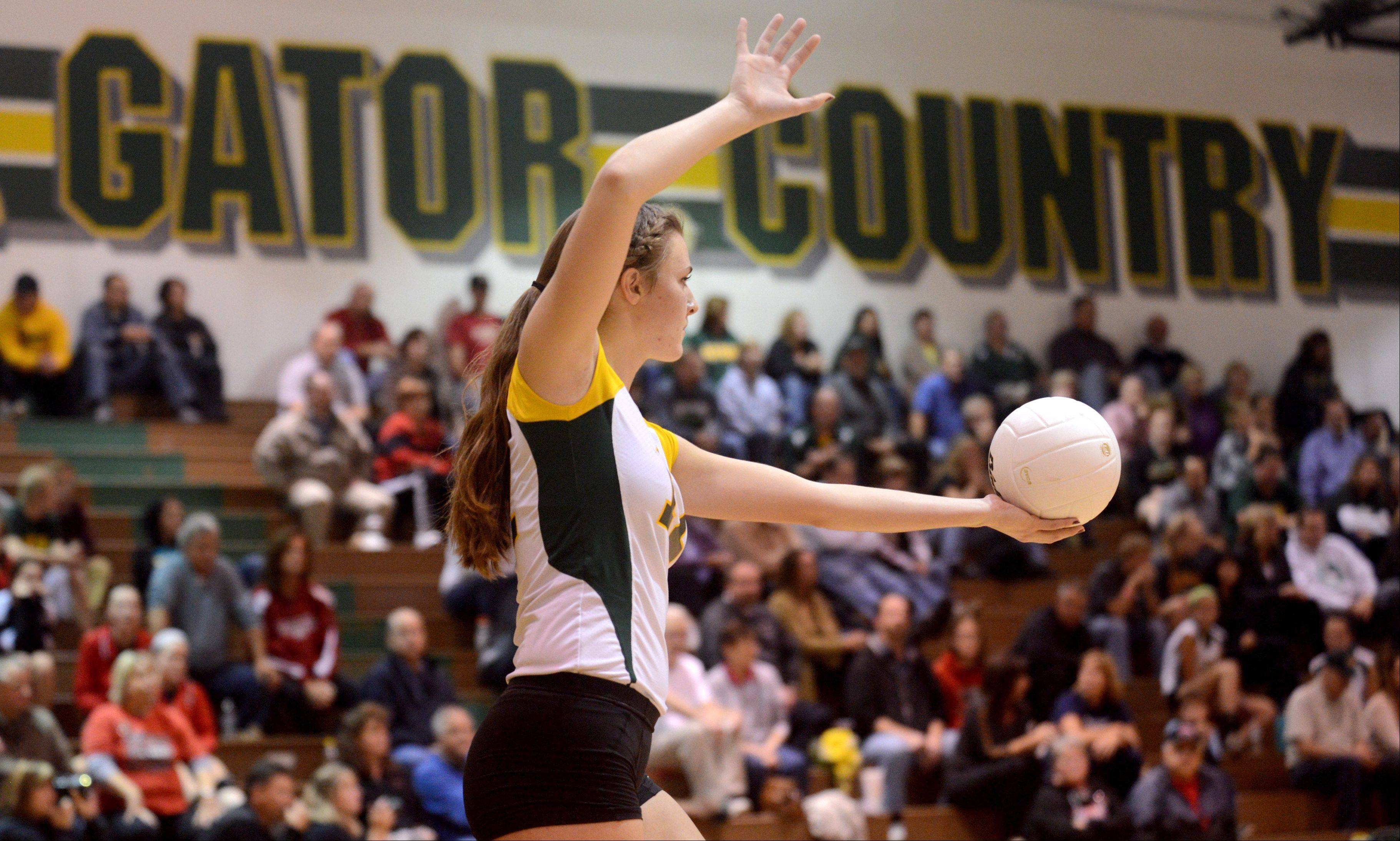 Crystal Lake South's Nicole Slimko prepares to serve the ball against Huntley during varsity volleyball at Crystal Lake on Thursday night.