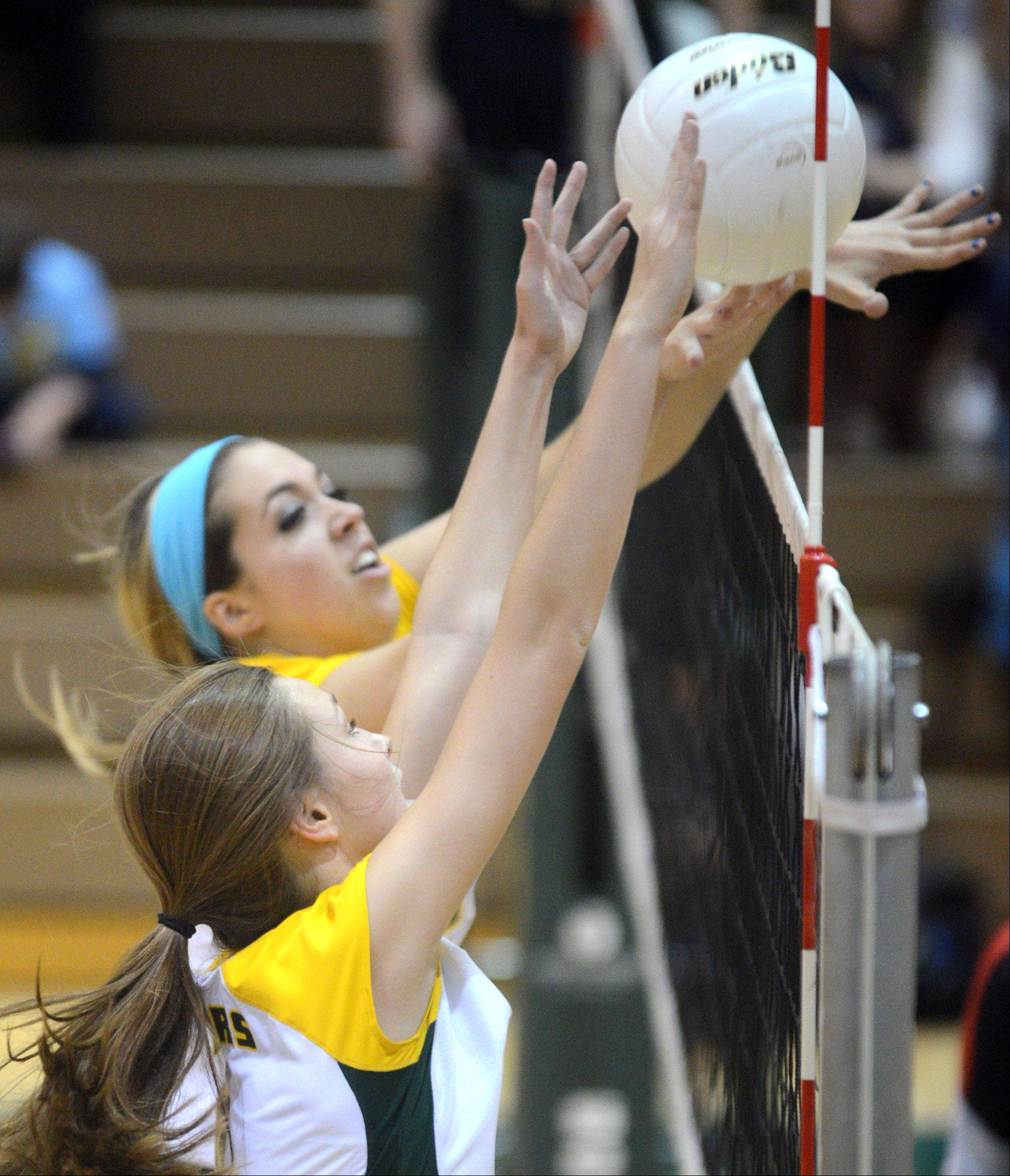 Crystal Lake South's Katy Hoenle, far, and Cassy Sivesind, near, block against Huntley during varsity volleyball at Crystal Lake on Thursday night.