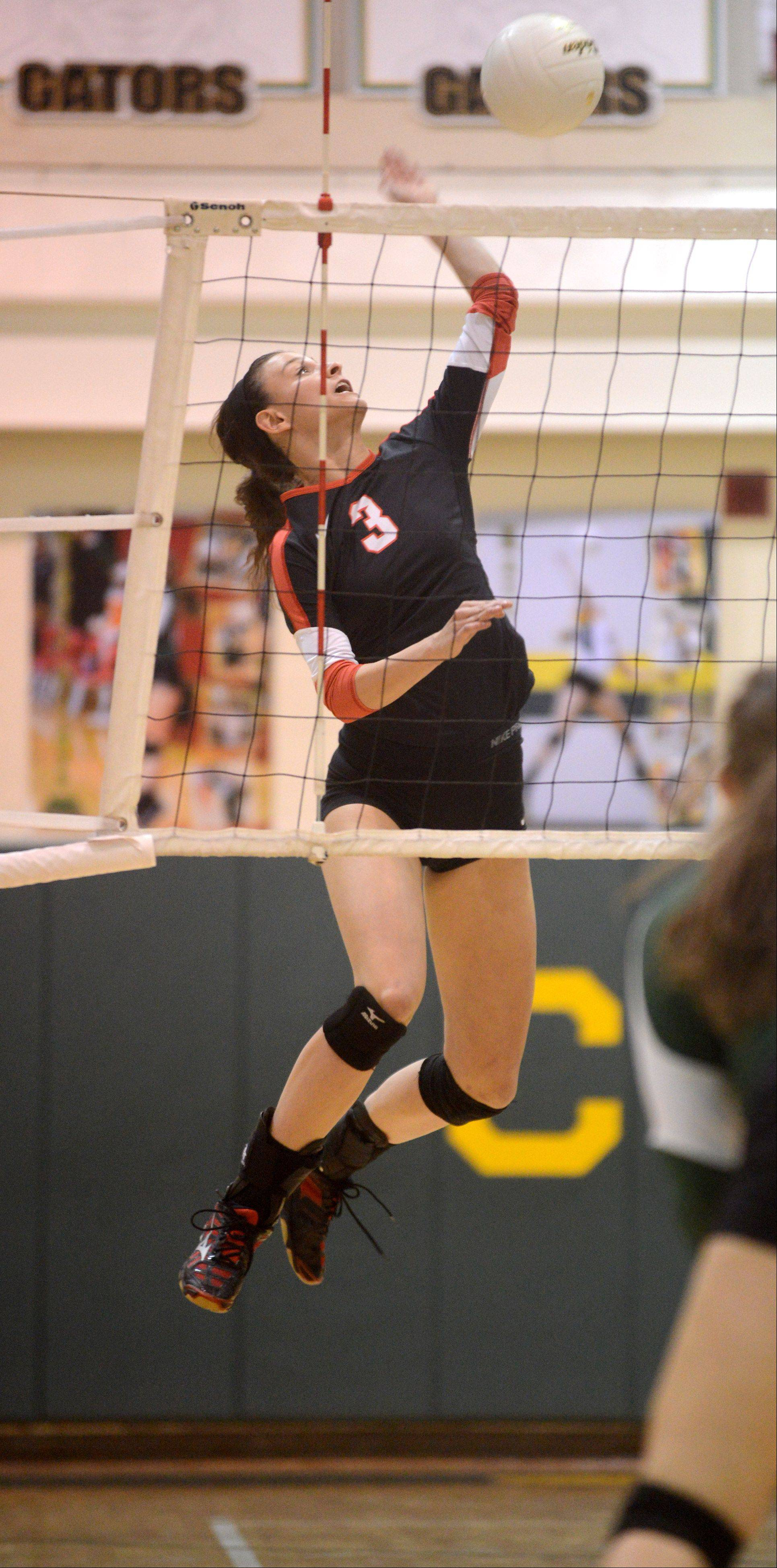 Huntley's Rachel Kisten hits the ball during varsity volleyball at Crystal Lake South on Thursday night.