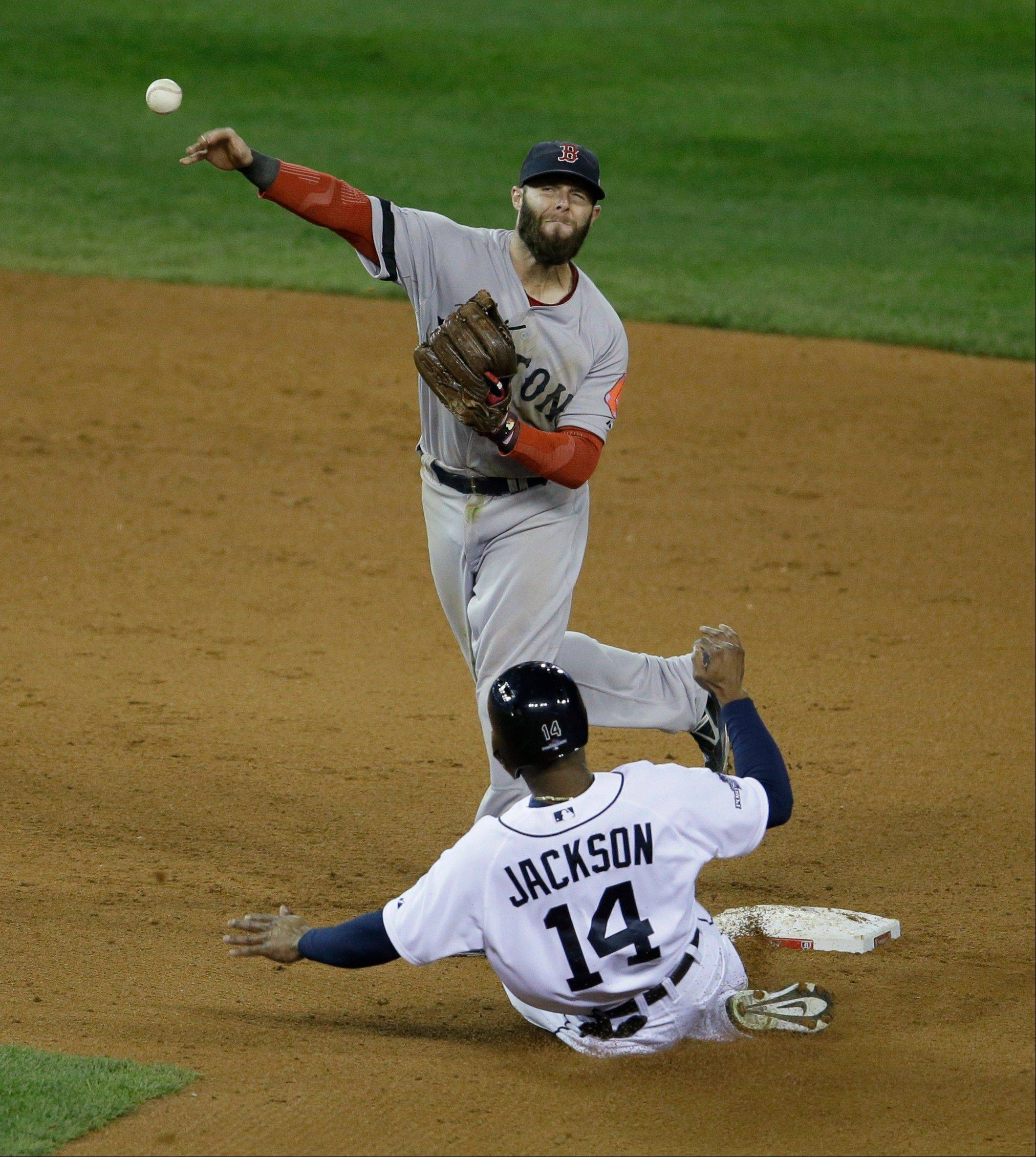 Red Sox second baseman Dustin Pedroia throws to first after forcing Detroit's Austin Jackson out at second in the sixth inning.