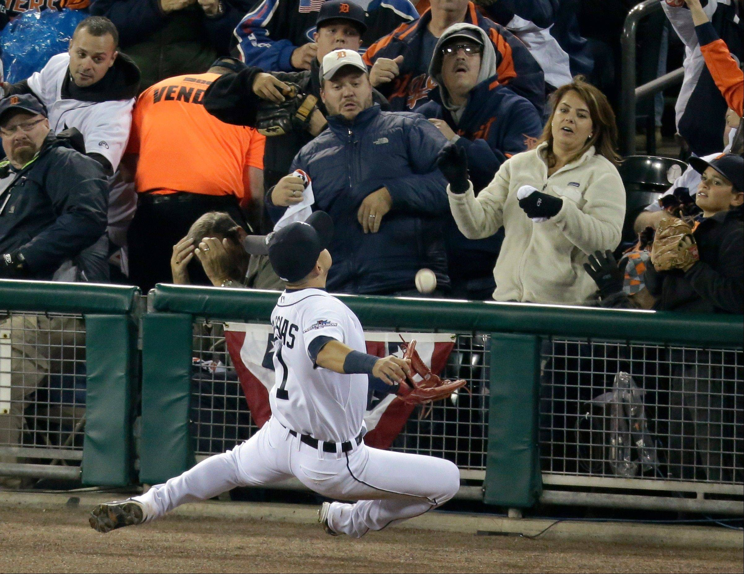 Tigers shortstop Jose Iglesias tries to make a play on a ball hit by Boston 's Mike Carp in the sixth inning.