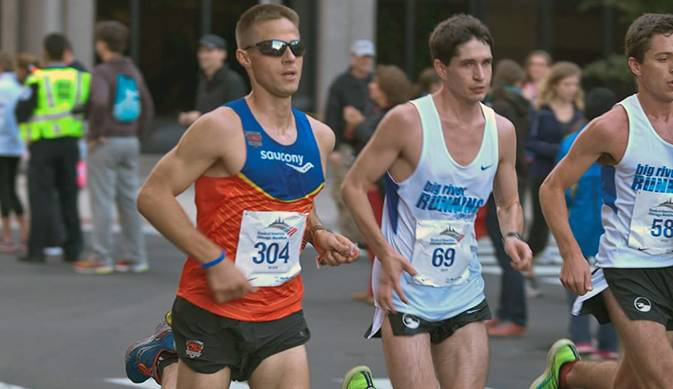 Harper assistant cross country coach Eric Wallor (left) competing in the 2013 Chicago Marathon.