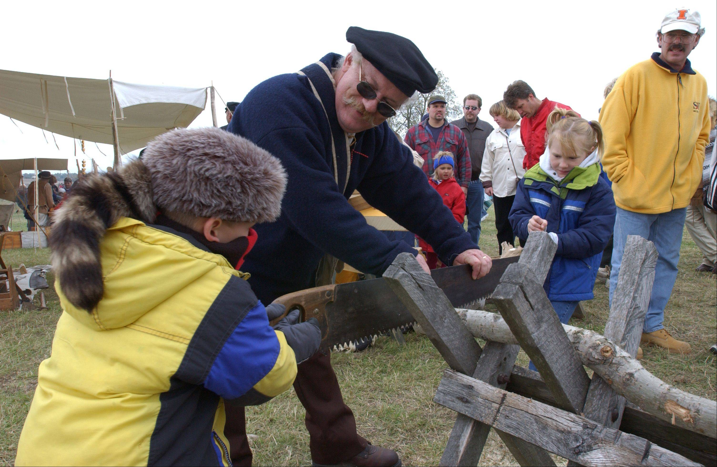 Visitors to the Trail of History can try their skill at using a two-man saw.