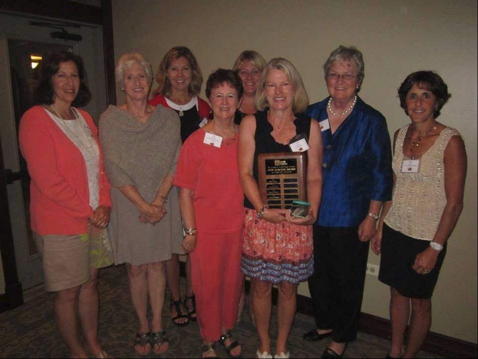 Former Judy Burgess Award winners pose with Connie Meister at the Friends Fall Fashion Show. From left to right, back row, Bobbi Alderfer (2003) and Maureen Bird (2007); front row: Diane Gibson (2004), Ann Alexander (2009), Judy Burgess (1998), Connie Meister (2013), Wendy Bangs (2011) and Joanne Spitz (2011).