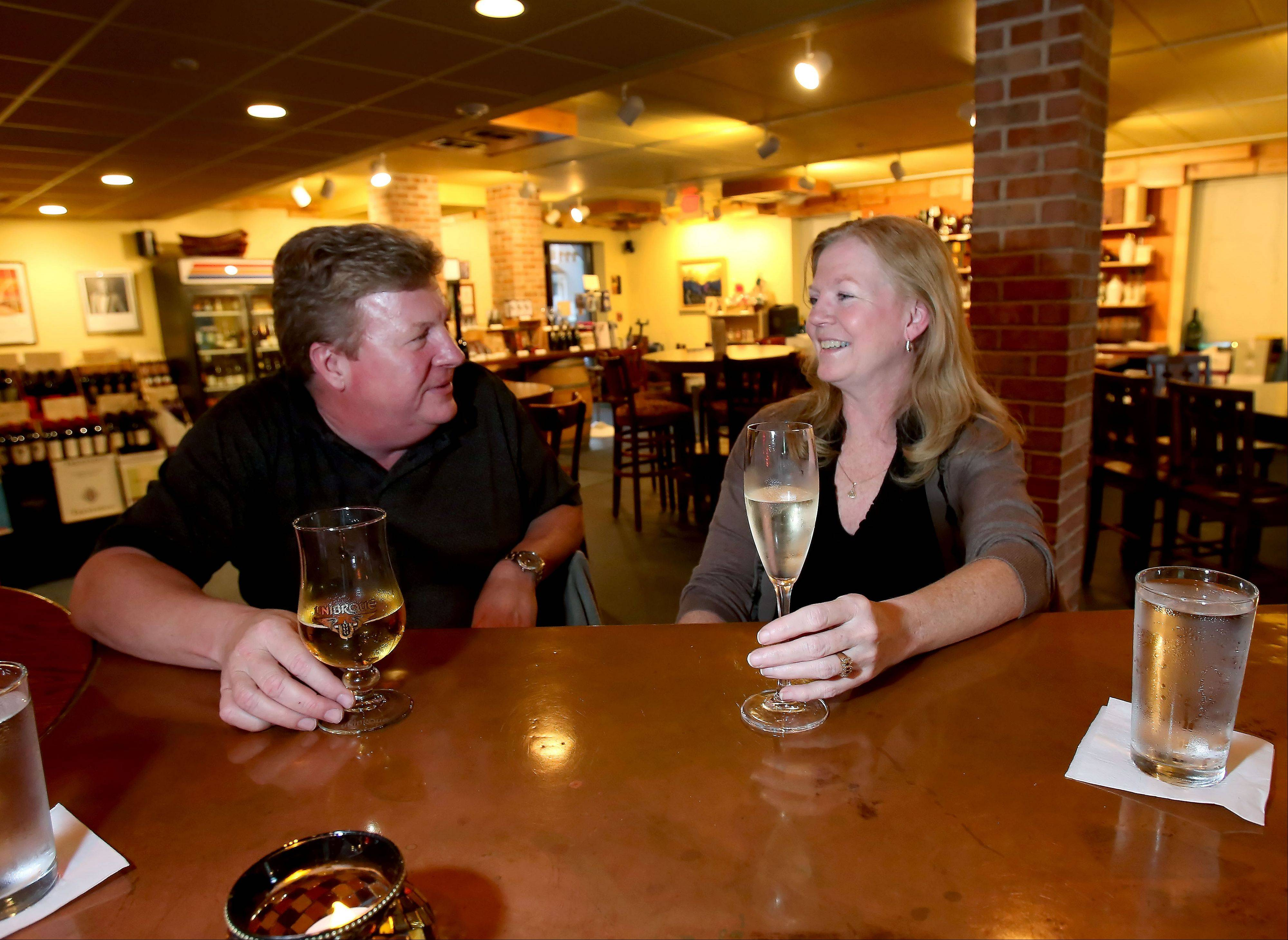 Regular customers Coleen and Brian Graham enjoy drinks at Wine With Me in Itasca.