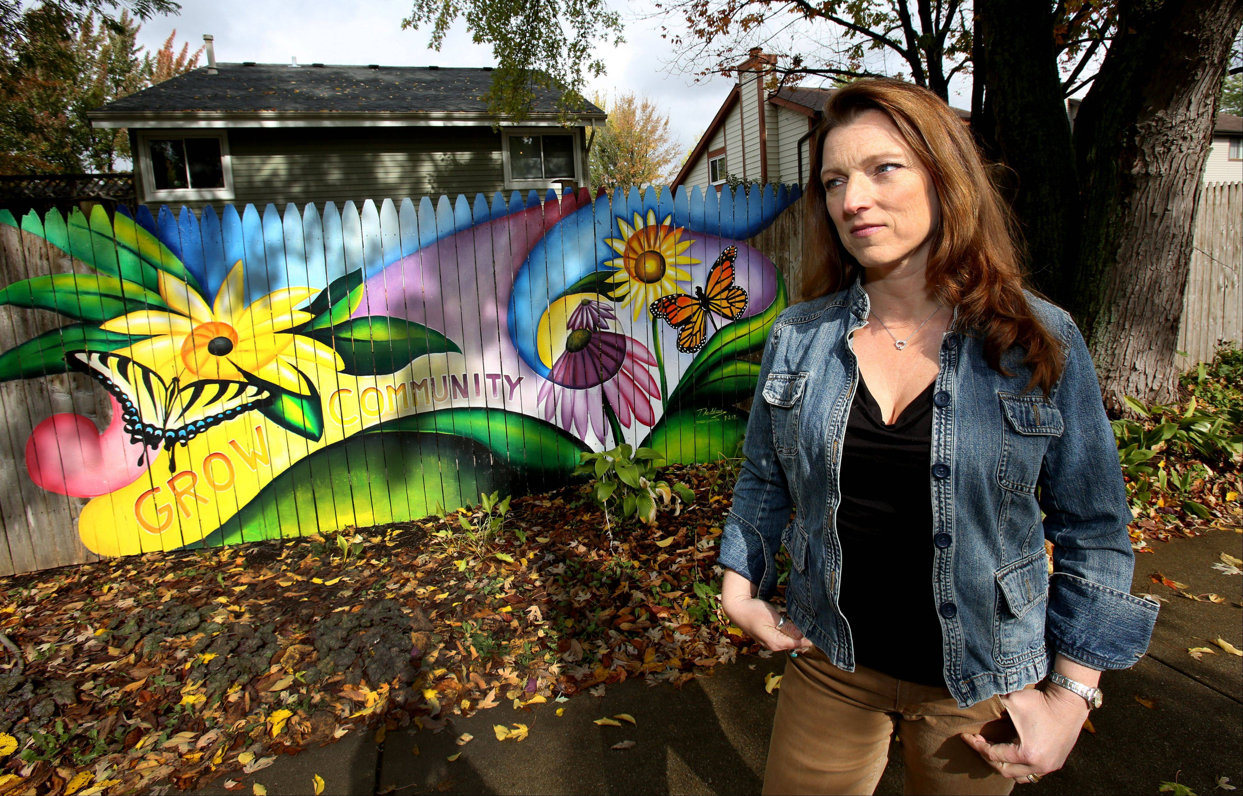 "Warrenville resident Shawna Coronado is being fined $30 a month by her homeowners association for her experiment ""to keep graffiti at bay in a beautiful way."""