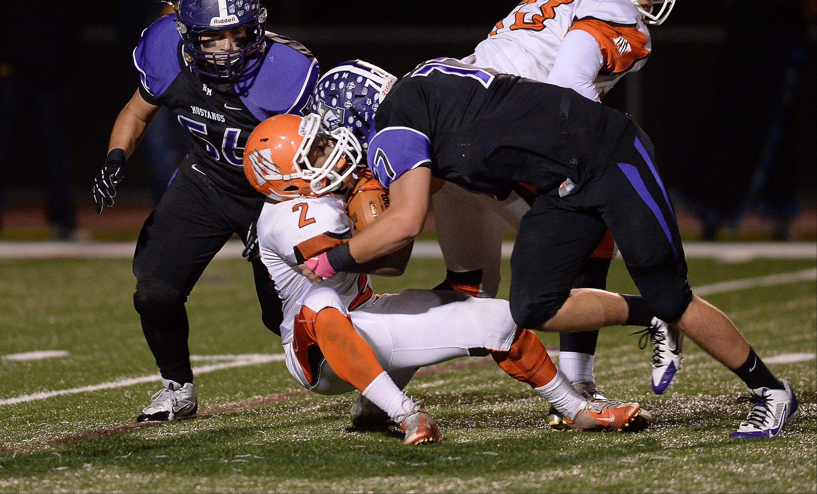 Rolling Meadows� Matt Long stops Hersey�s Mario Thomas in the second quarter.