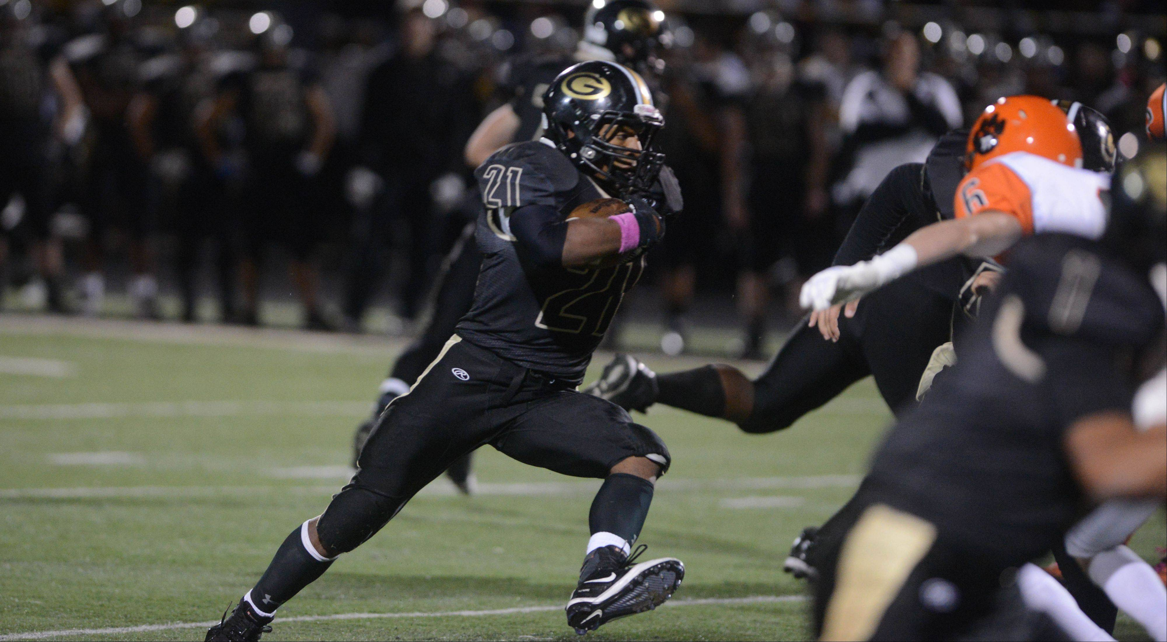 Justin Jackson of Glenbard North looks for running room.
