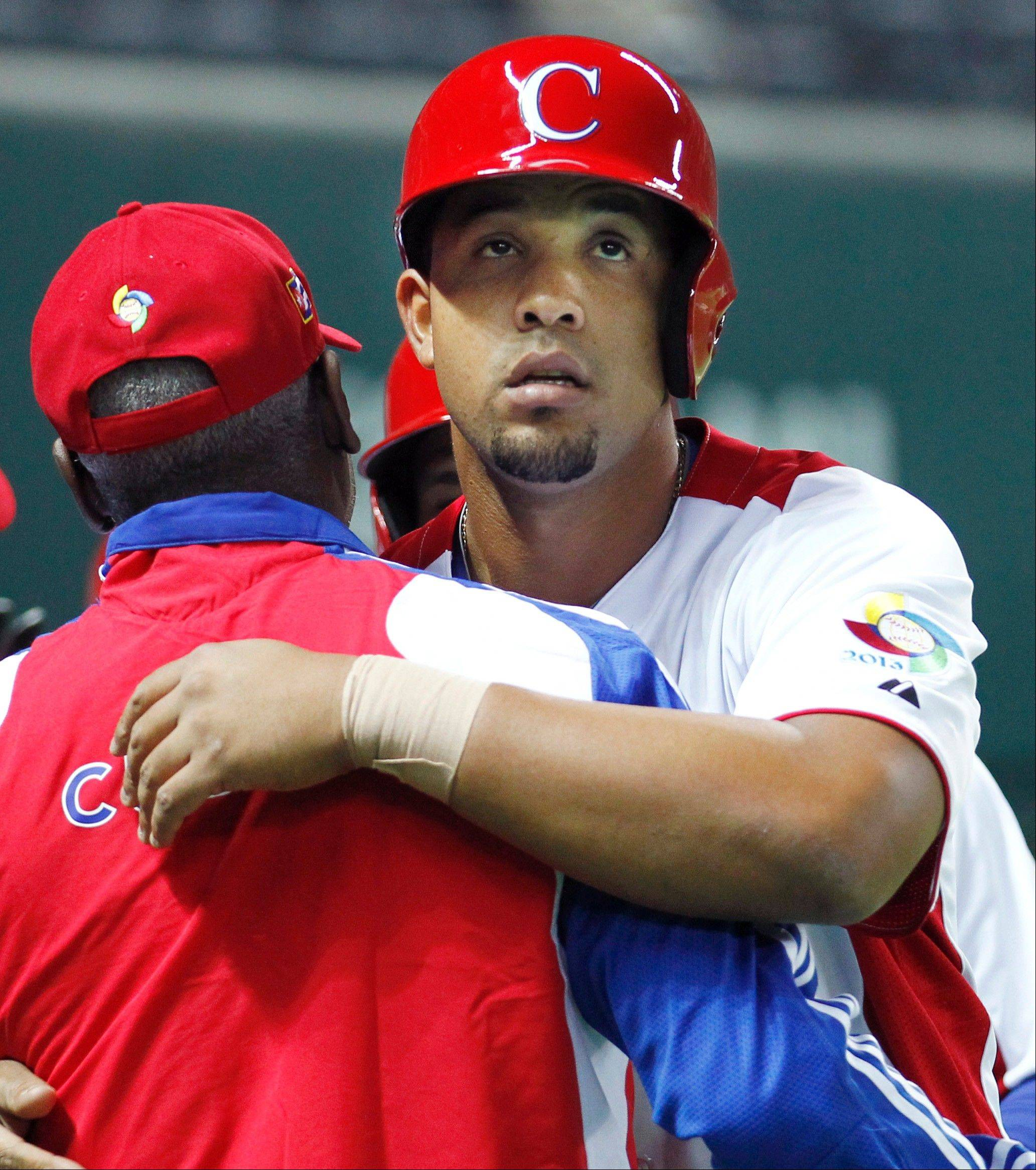Cuba's first baseman Jose Abreu celebrates after he hits a grand slam in the fifth inning of their World Baseball Classic first round game against China in Fukuoka, Japan, Monday, March 4, 2013. (AP Photo/Koji Sasahara)