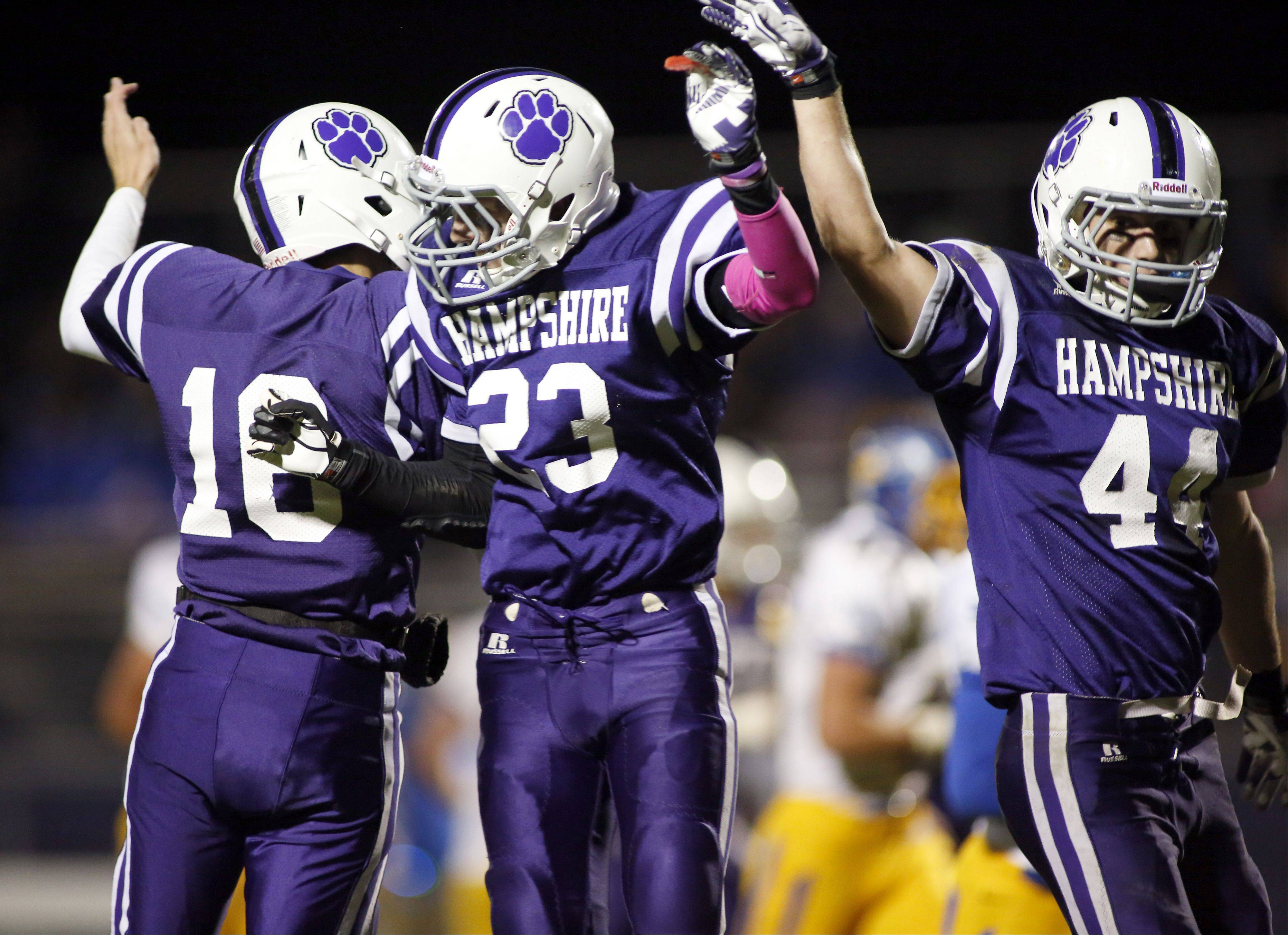Hampshire�s Nick Mohlman celebrates a touchdown with Trey Schramm and Mason Fleury .