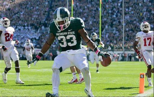 Michigan State�s Jeremy Langford celebrates his 32-yard touchdown run during last Saturday�s home win over Indiana.