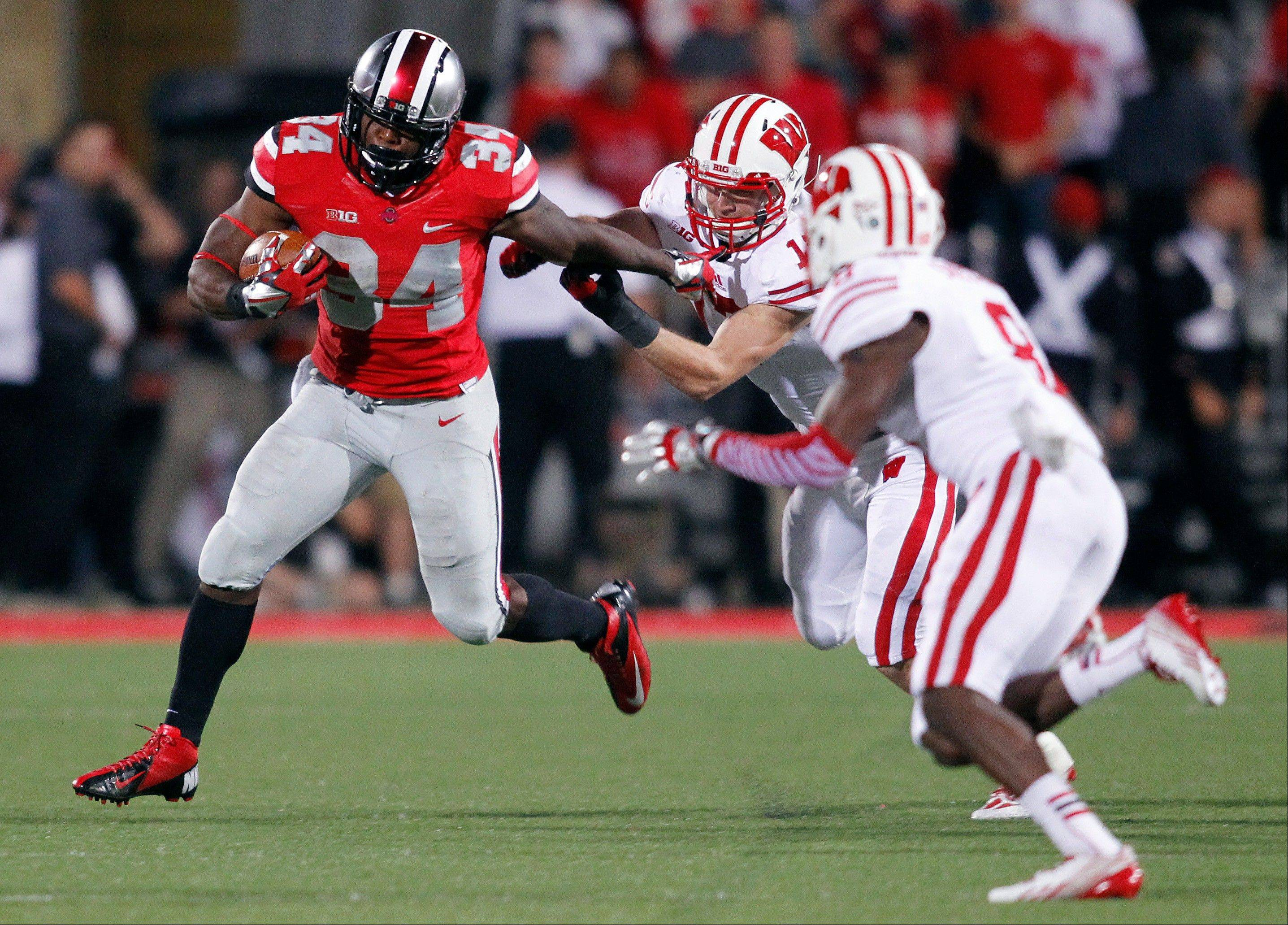 Ohio State running back Carlos Hyde, left, tries to get around Wisconsin defenders during the fourth quarter of the Sept. 28 game in Columbus, Ohio. Iowa has yet to give up a rushing TD this season.