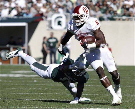Indiana�s Tevin Coleman avoids a tackle by Michigan State�s Darian Hicks during the first quarter of last week�s game in East Lansing, Mich.