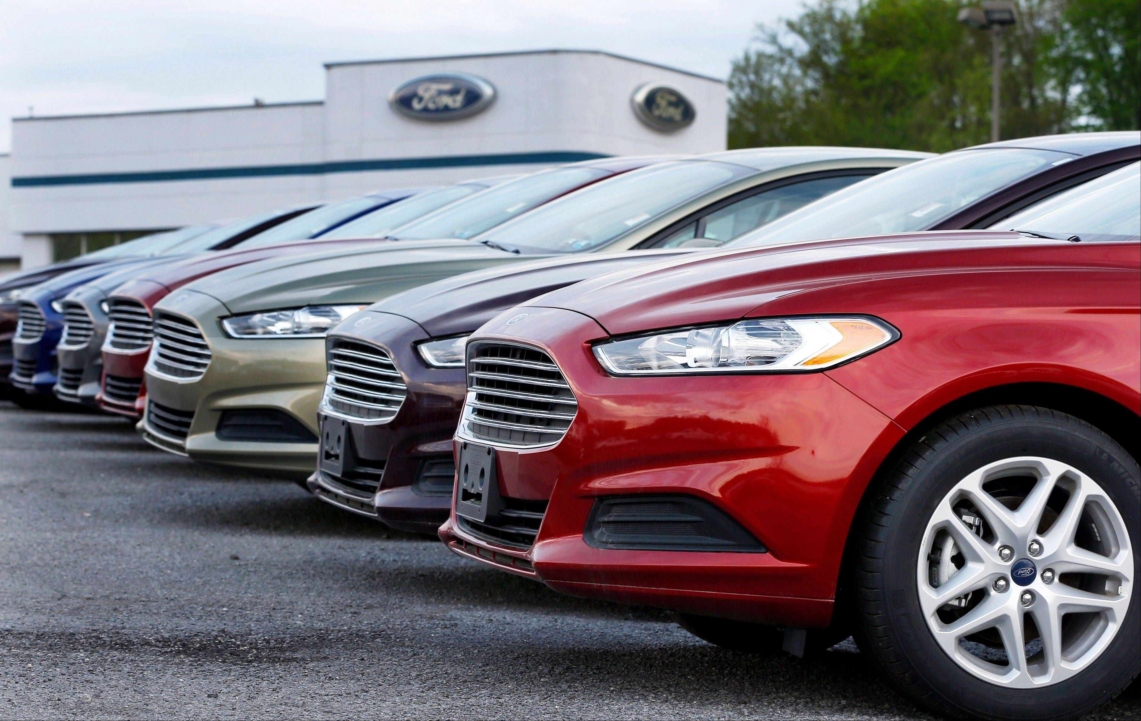 A row of new 2013 Ford Fusions are on display at an automobile dealership in Zelienople, Pa. Data collected by J.D. Power and Associates show that sales fell in the second week of October as the partial shutdown of the government and the debate over the nation's borrowing dragged on.