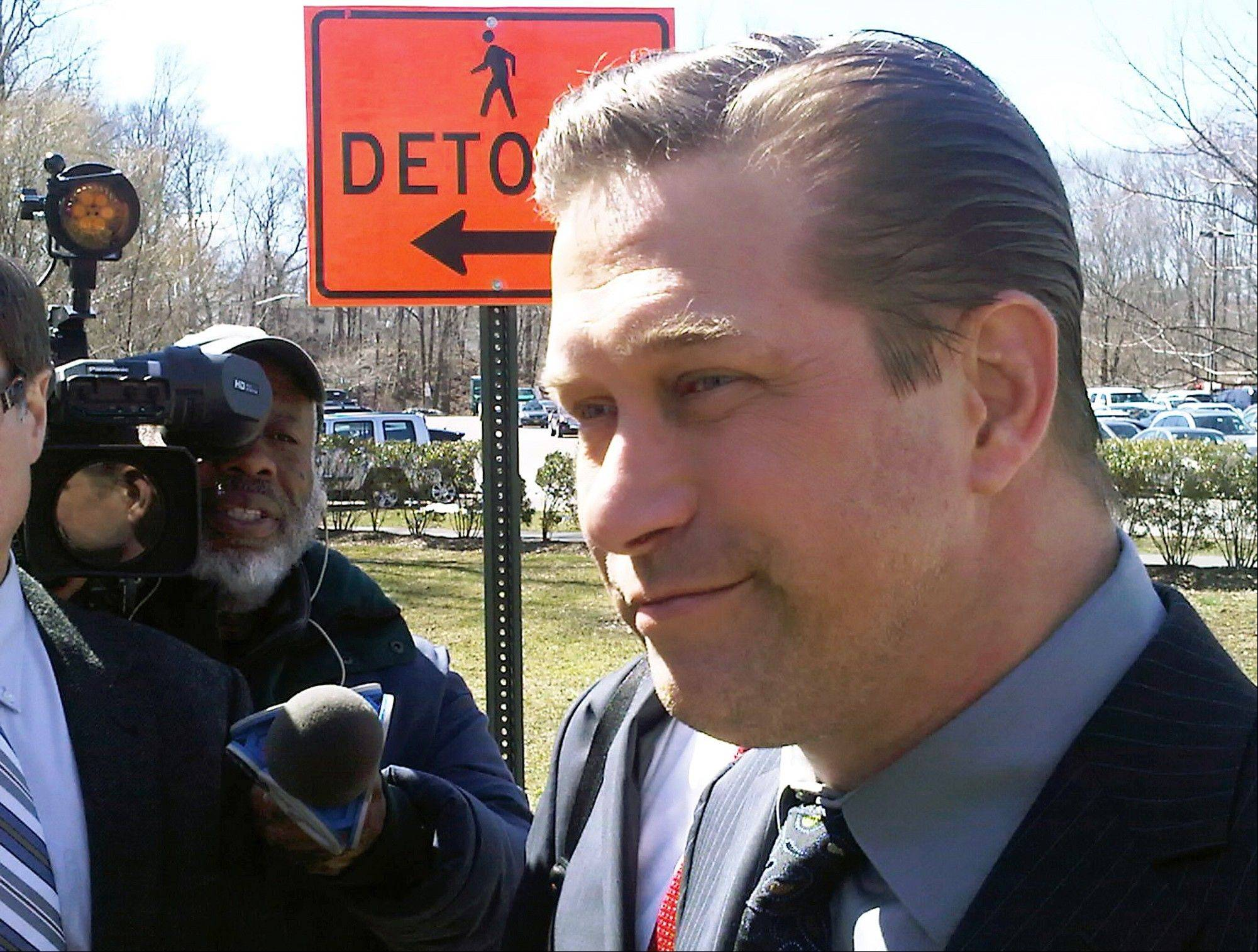 Actor Stephen Baldwin leaves Rockland County Court in New City, N.Y., after admitting he failed to pay New York state income taxes for the years 2008, 2009 and 2010. Baldwin's attorney said he will turn over $100,000 Friday toward his delinquent New York tax bill.