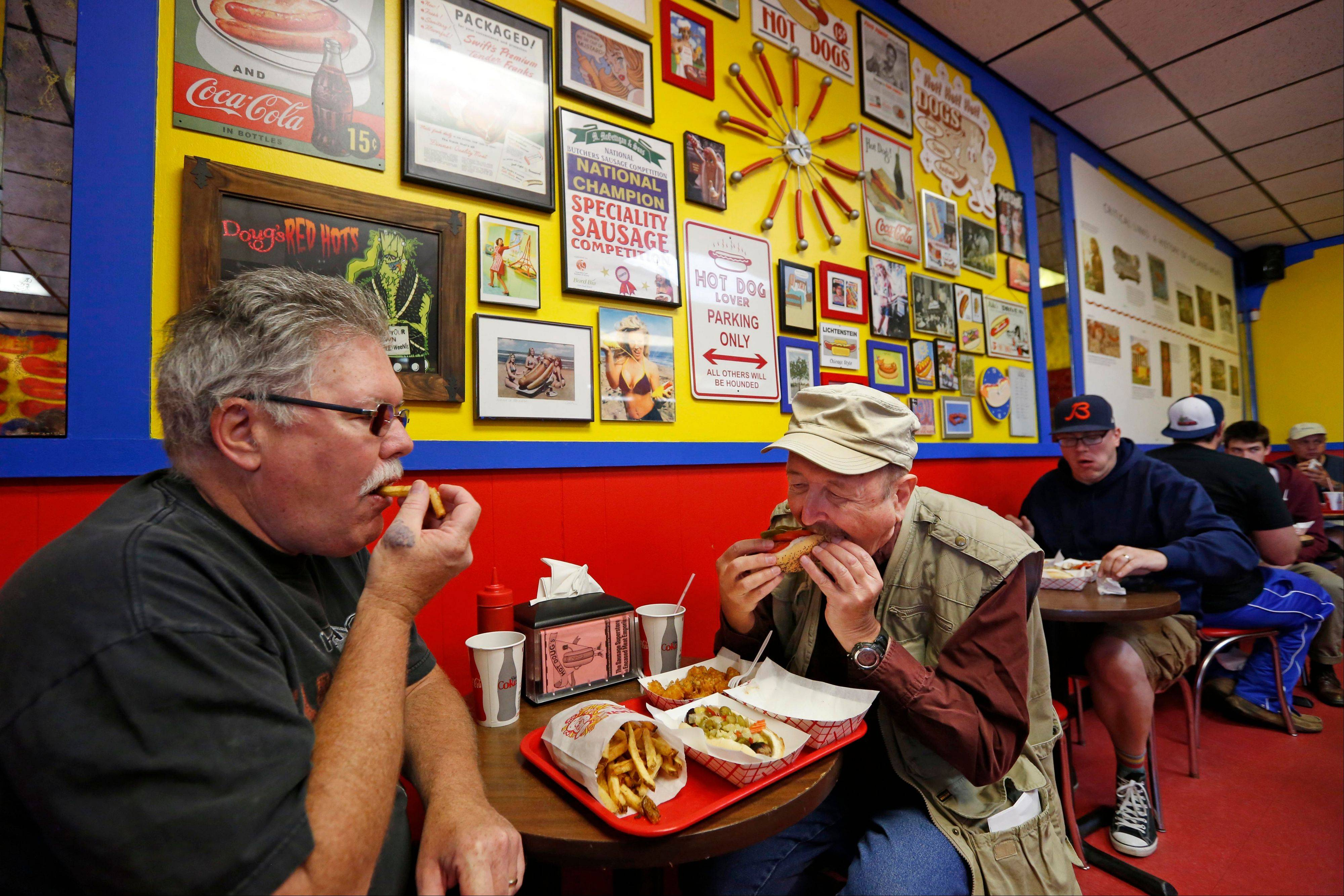 "Customers nosh on their sausages at Doug Sohn's Hot Doug's, which has been called ""The Sausage Superstore and Encased Meat Emporium."""