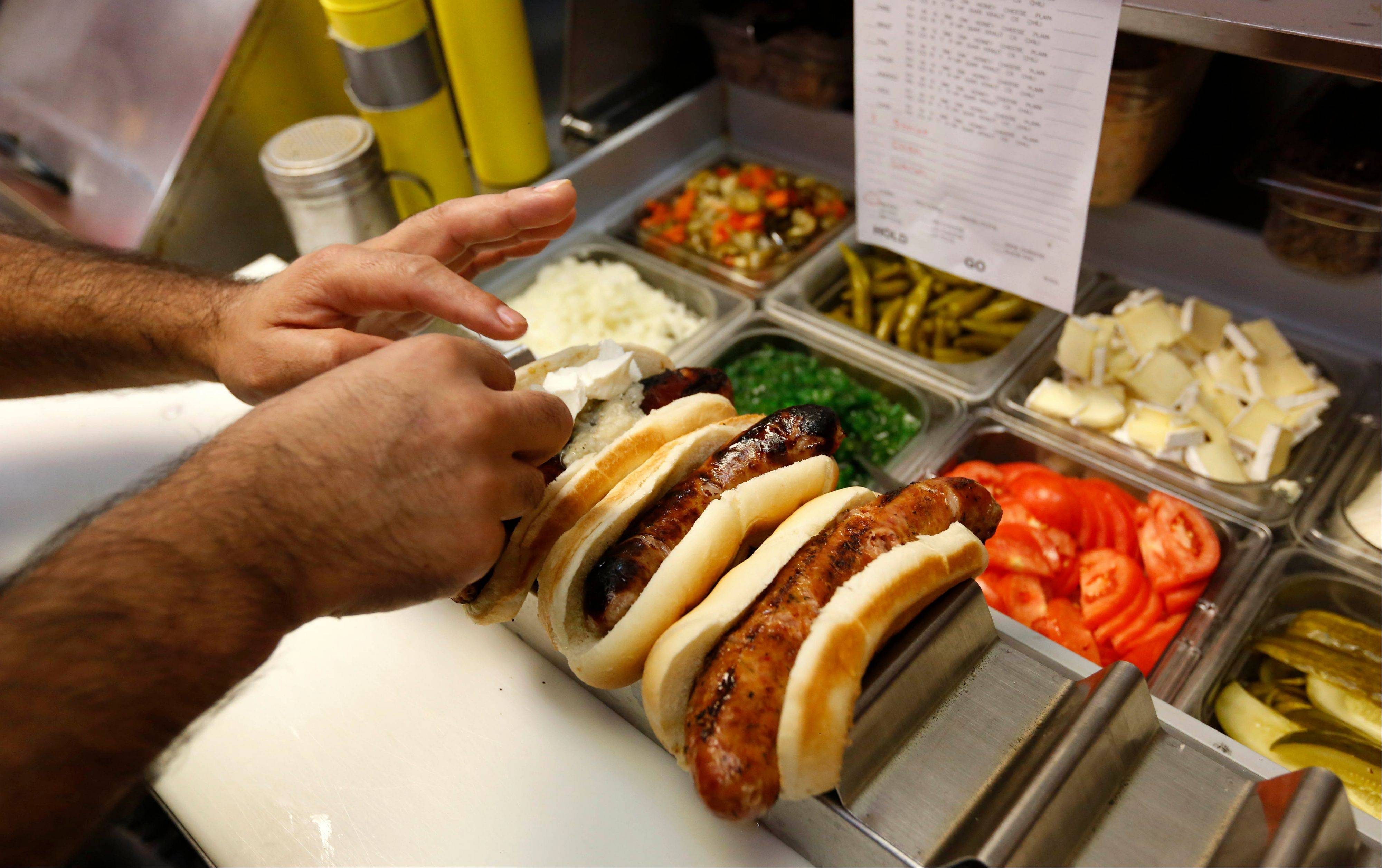 The gourmet sausages at Hot Doug's might get dressed with cherry-apricot mustard, double cr�me brie cheese and pate de campagne.