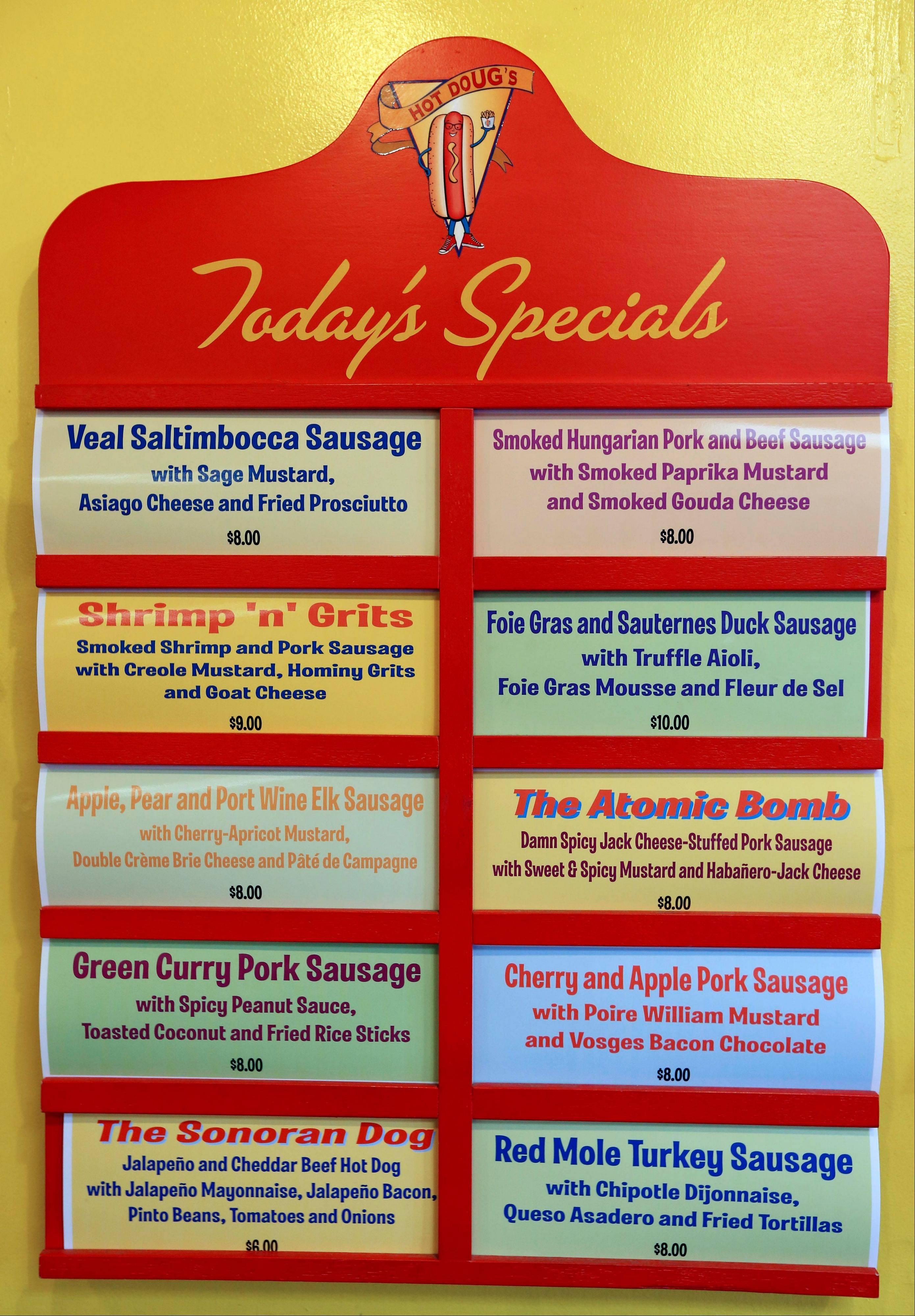 A specials menu adorning the wall at Hot Doug's offers gourmet sausages like Green Curry Pork Sausage and more.