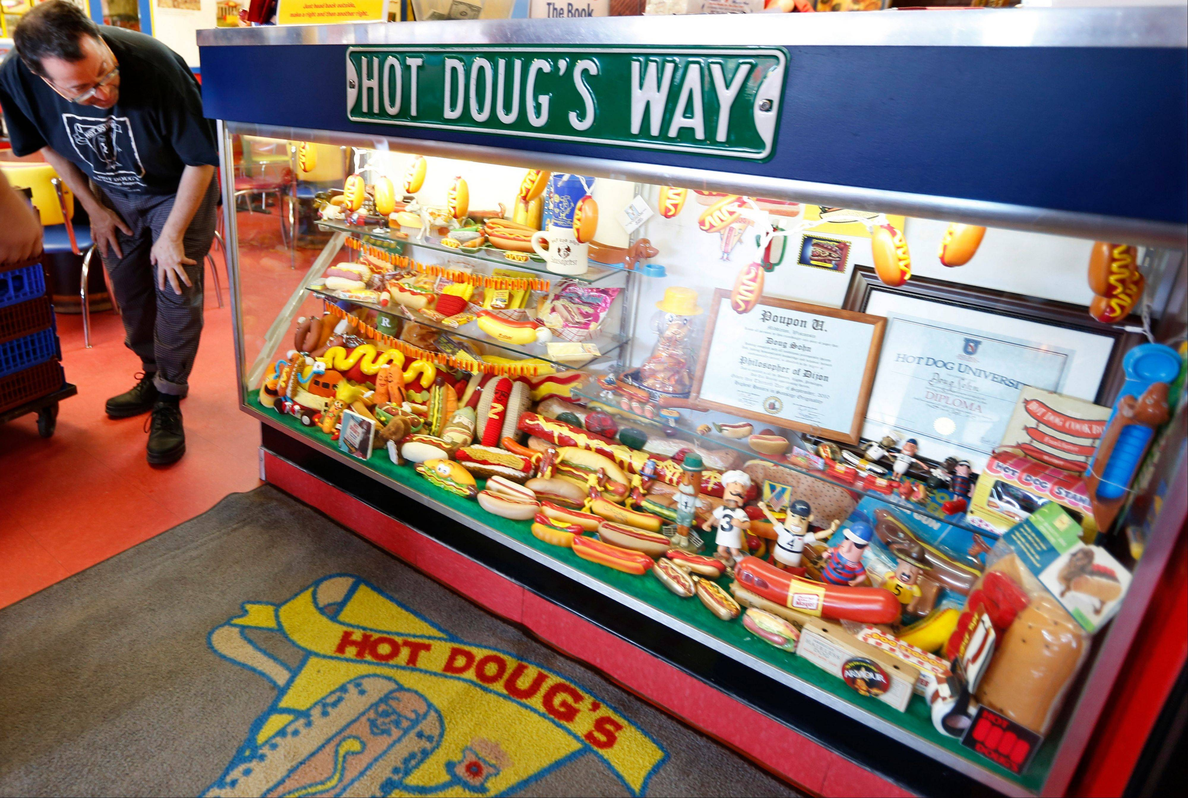 Stop by the display case of hot dog memorabilia at Hot Doug's in Chicago.