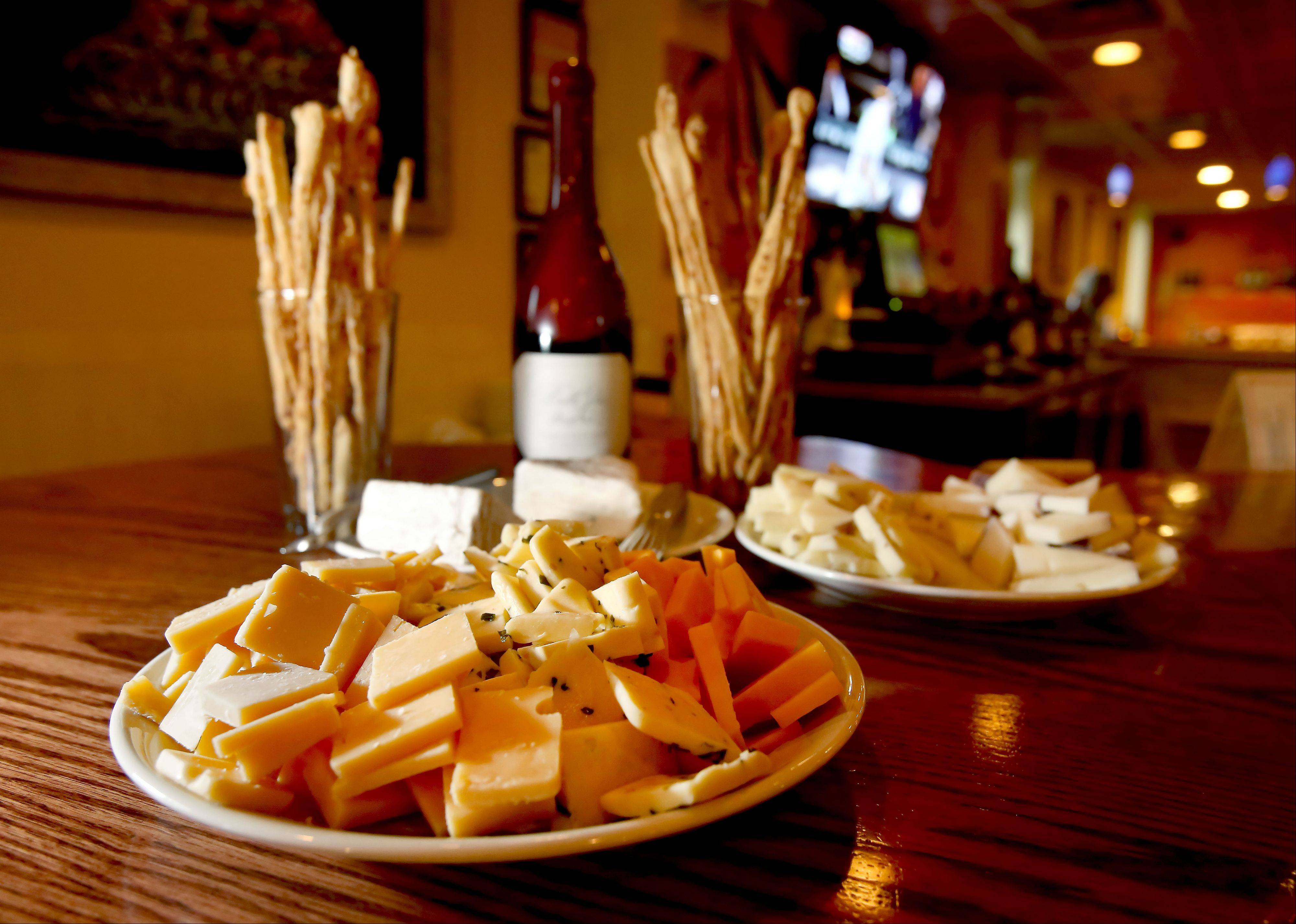 A selection of cheeses can be enjoyed with a glass of wine or craft beer at Wine With Me in Itasca.