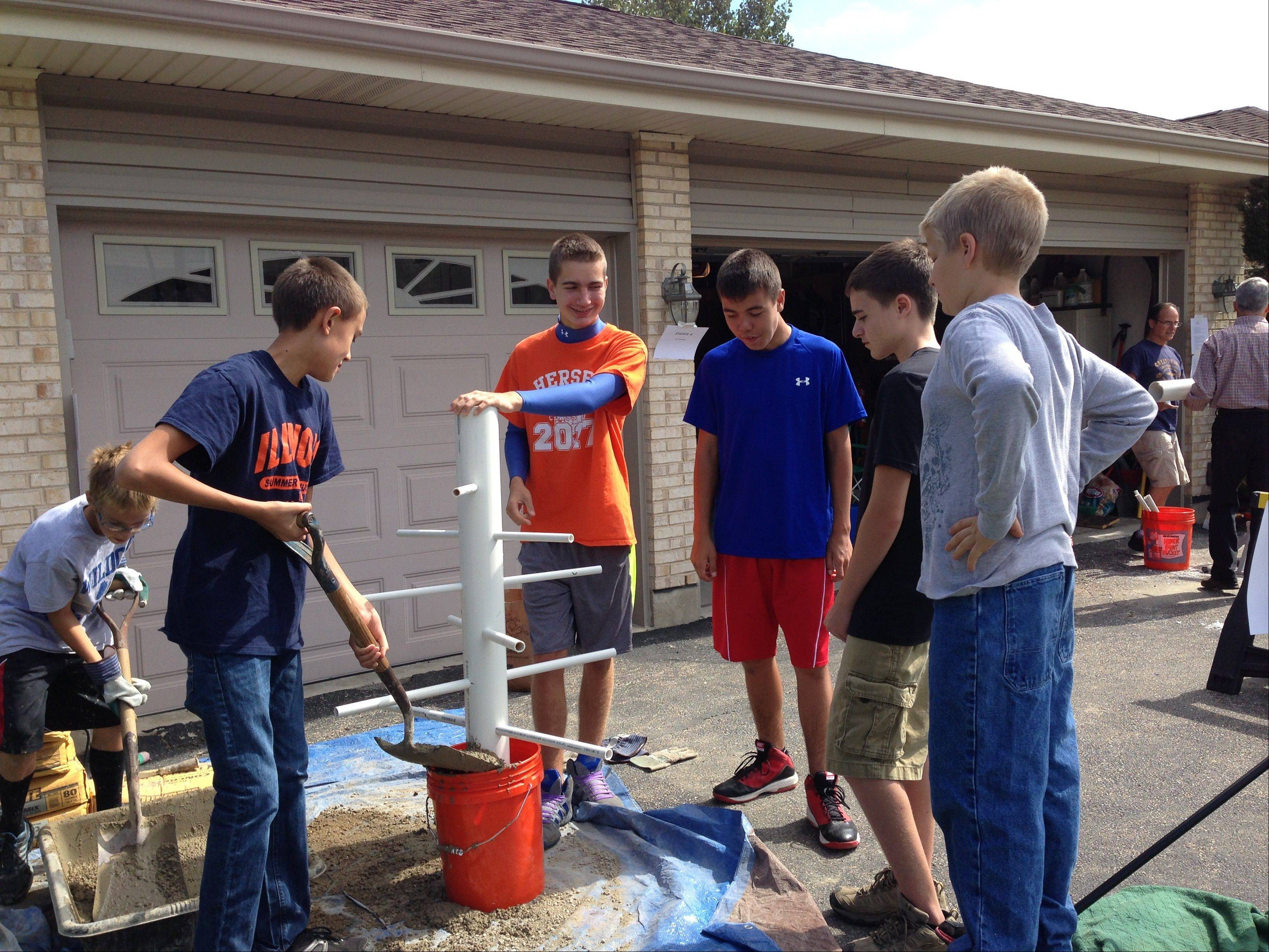 Cameron Sato, in the royal blue T-shirt, with friends who helped him build fish cribs that Cameron later installed at Axehead Lake and Belleau Lake in Des Plaines as part of an Eagle Scout project. The cribs give smaller, growing fish protection from larger predators.