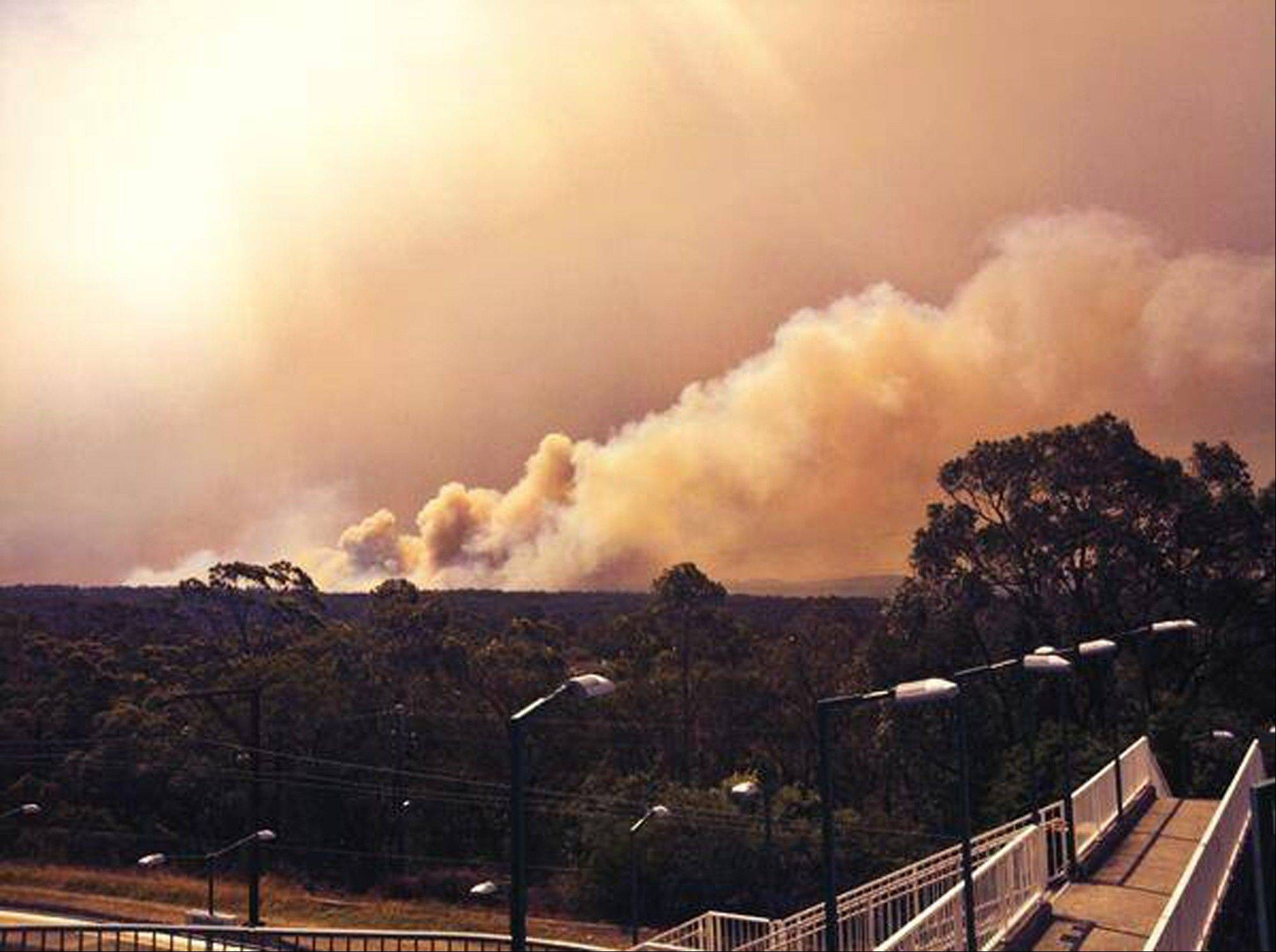Smoke rises from a fire Thursday near Springwood, west of Sydney.