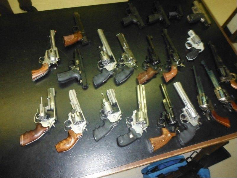 Cook County sheriff's deputies recovered 22 handguns among 38 firearms found at a Schaumburg house during an eviction processing Thursday.