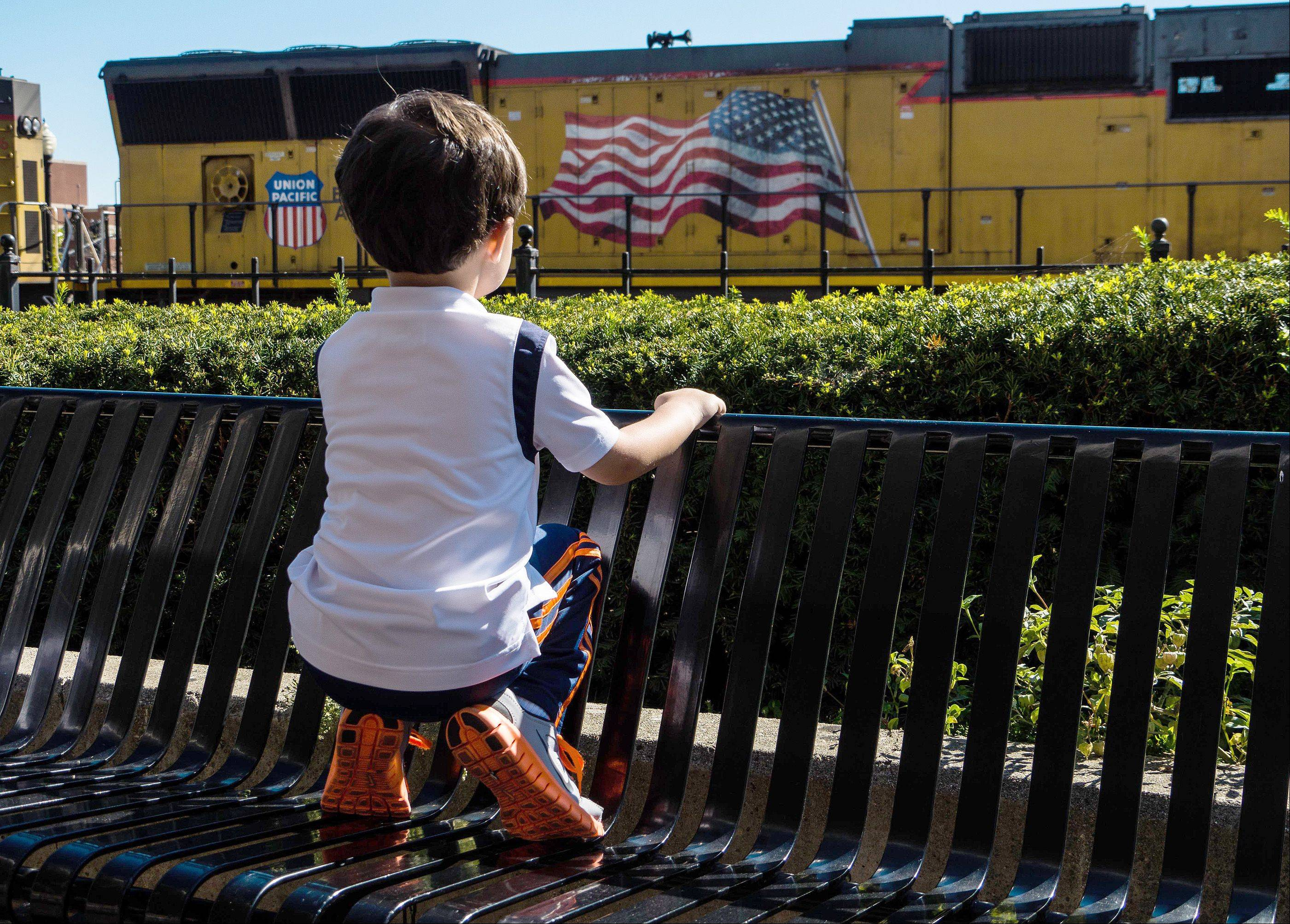 My grandson loves trains. This was taken at the fountain plaza in downtown Wheaton. He heard the train coming and ran to the bench to watch it roll by.