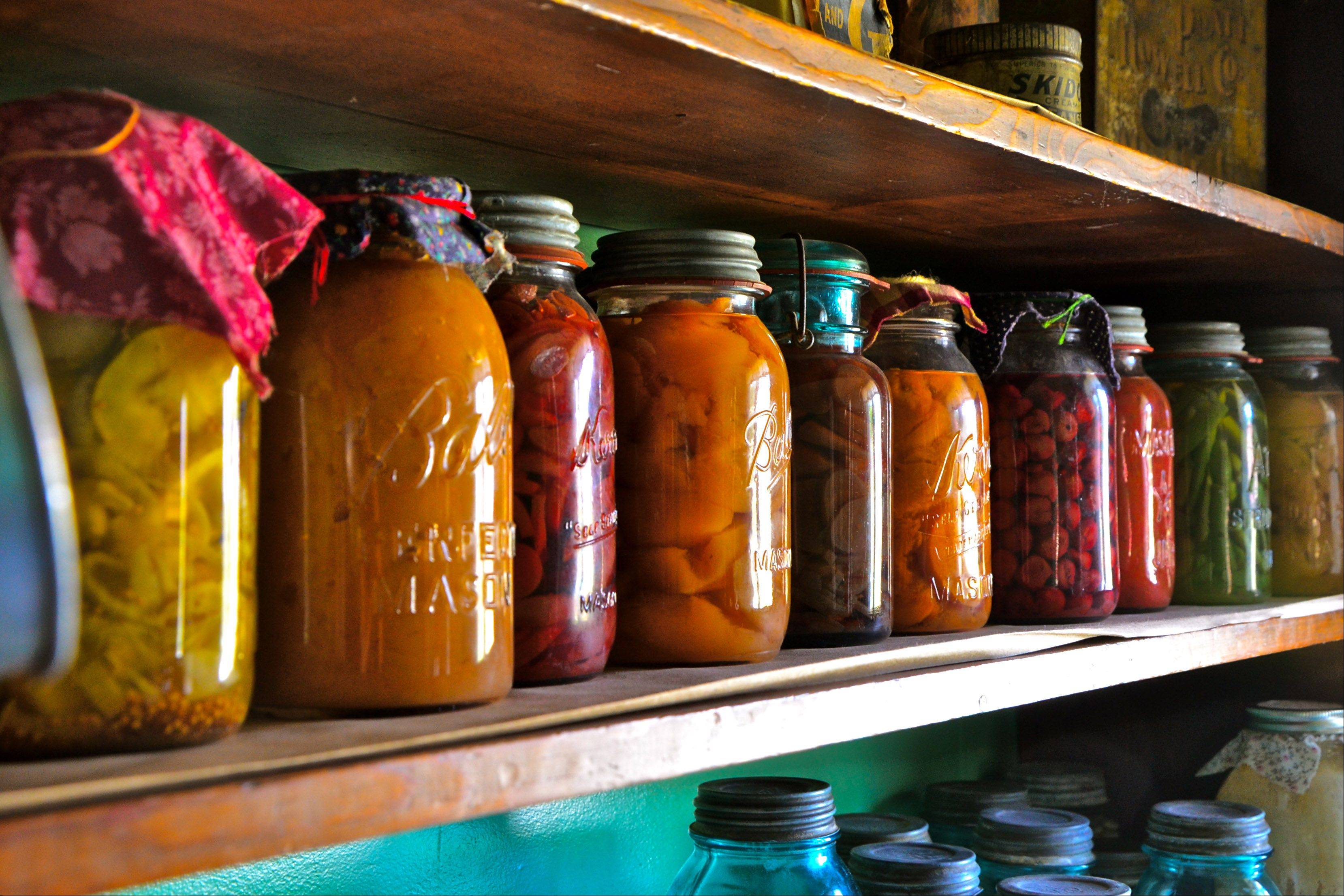 I took this picture at the Living History Farms in Urbandale Iowa. One of the farm houses had a pantry with this colorful group of canned foods in traditional glass Mason jars.