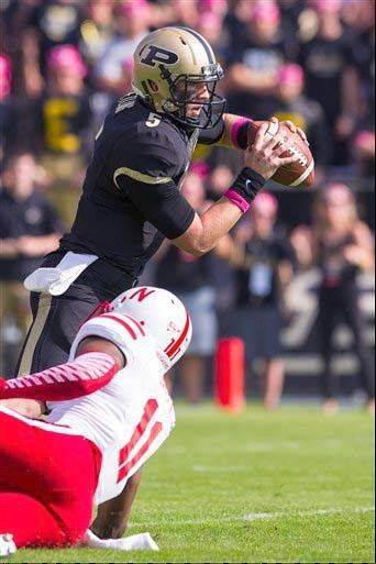 Purdue's Danny Etling tries to scramble away from Nebraska's Andrew Green during last week's game in West Lafayette, Ind.