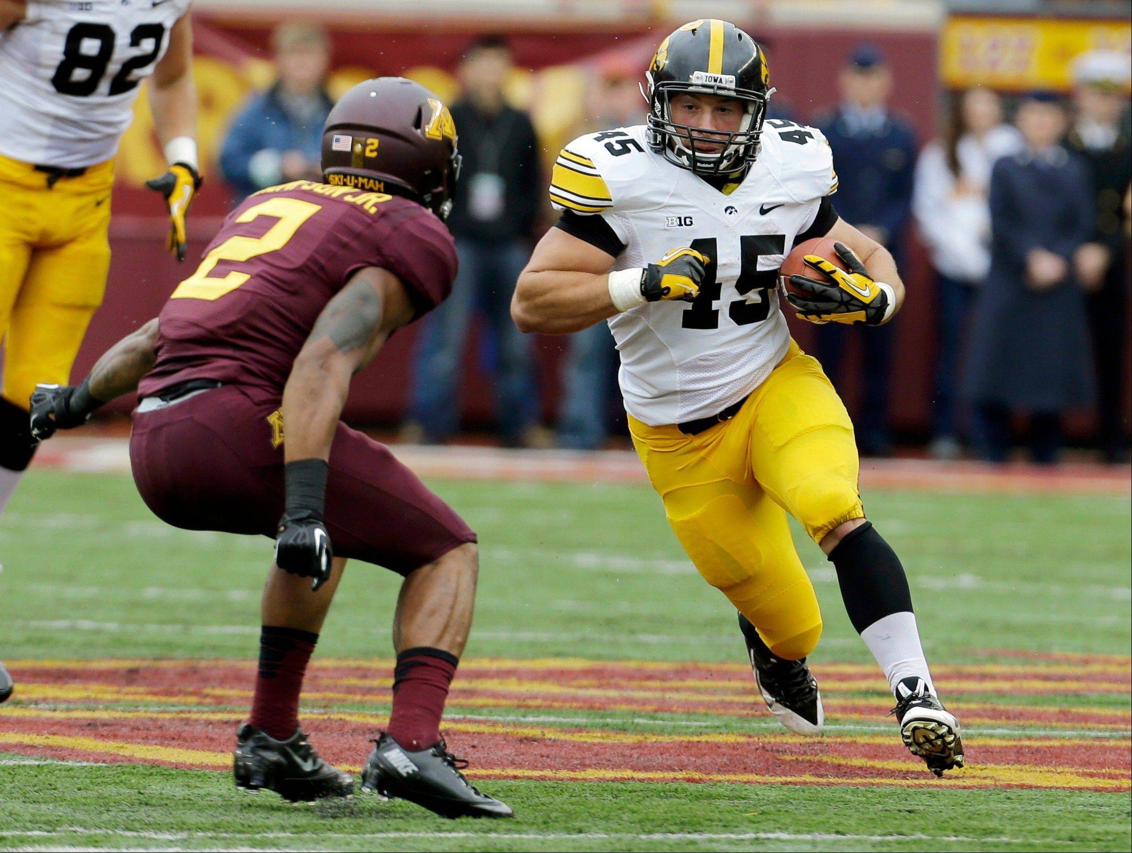 Hawkeyes fullback Mark Weisman, a Stevenson High School grad, carries the ball during the Sept. 28 game against Minnesota. Like Ohio State, Iowa favors chewing up yardage between the tackles.