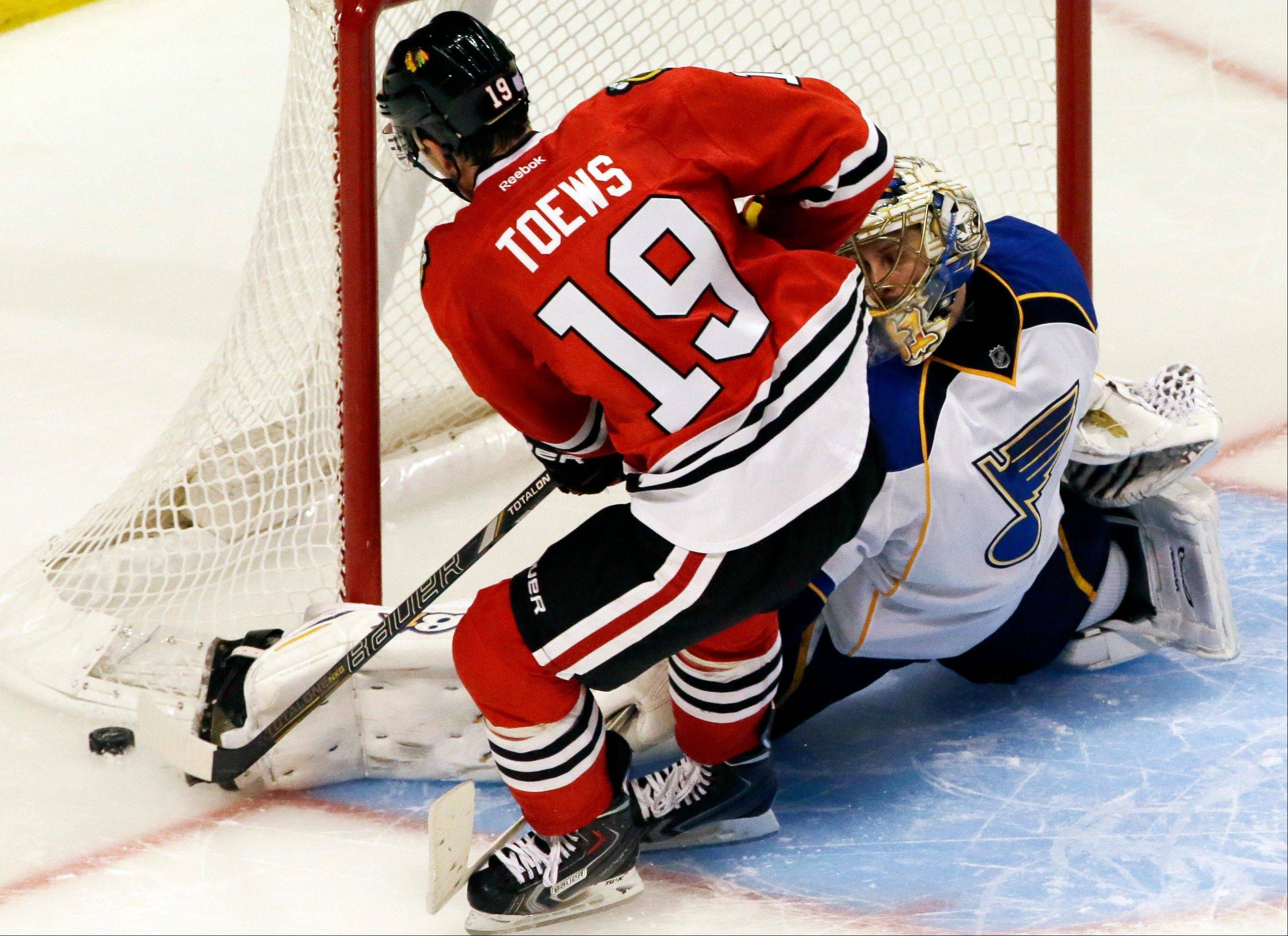 St. Louis Blues goalie Jaroslav Halak (41) blocks a shot by Blackhawks captain Jonathan Toews on Thursday. On Friday, coach Joel Quenneville broke up the scoring lines, splitting Toews and Patrick Kane.