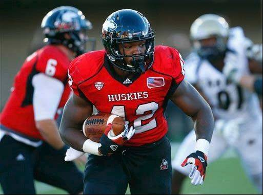 NIU's Cameron Stingily runs against Akron during the first half of last week's game in DeKalb. The Huskies' backfield ranks ninth in the FBS with an average of 282.7 yards per game.