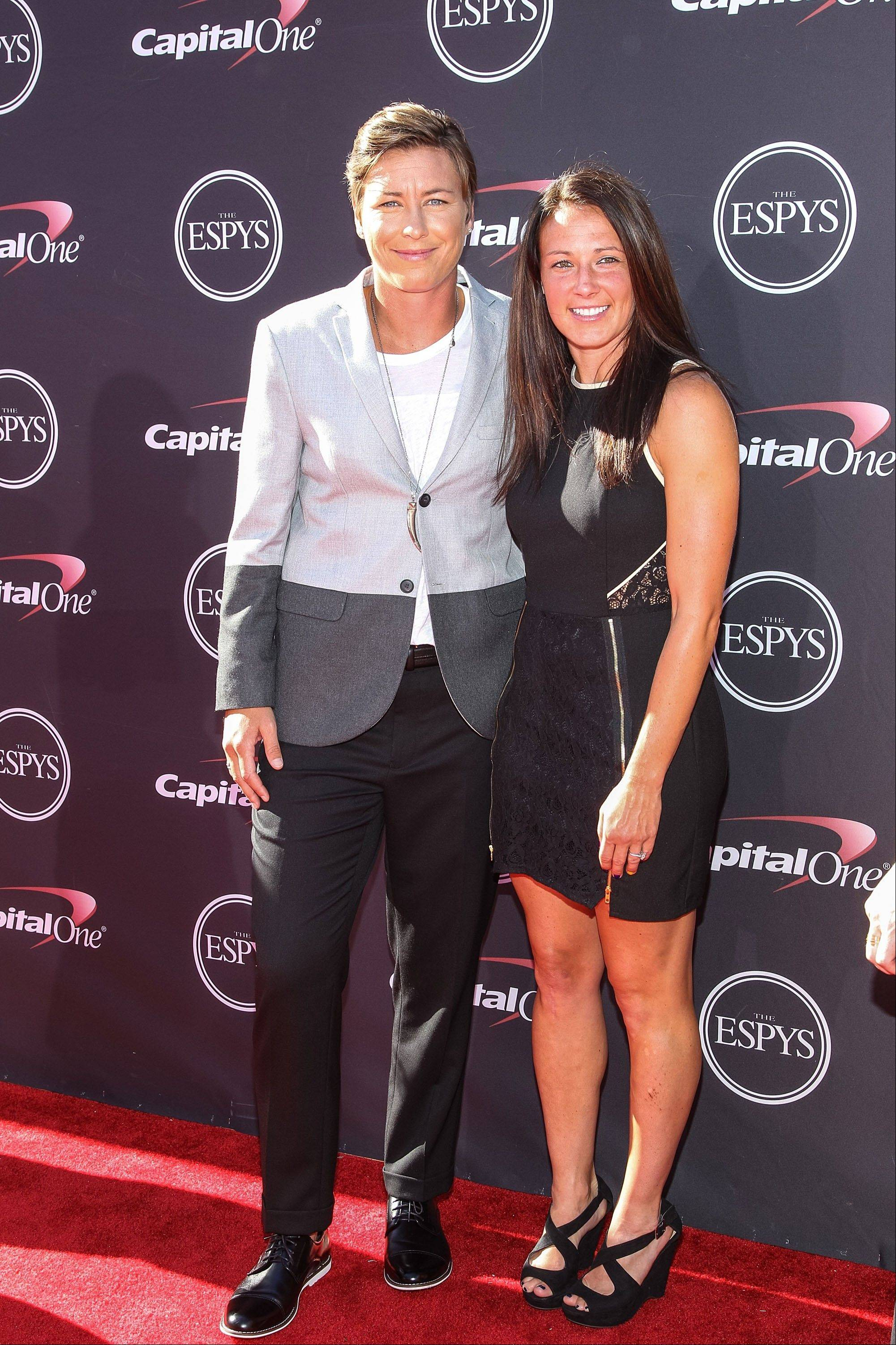 Soccer players Abby Wambach, left, and Sarah Huffman arrive for the ESPY Awards in Los Angeles. They were married earlier this month in Hawaii.