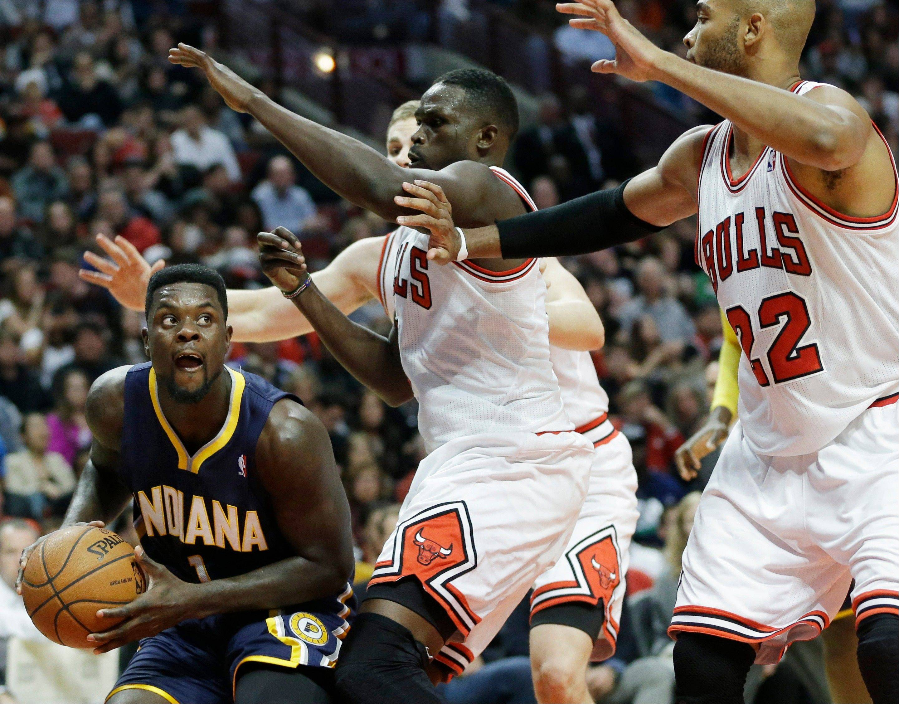 Indiana Pacers guard Lance Stephenson (1), left, looks to pass as Chicago Bulls' Luol Deng (9), Erik Murphy (31) and Taj Gibson (22) guard during the second half of an NBA preseason basketball game in Chicago on Friday, Oct. 18, 2013. The Bulls won 103-98.