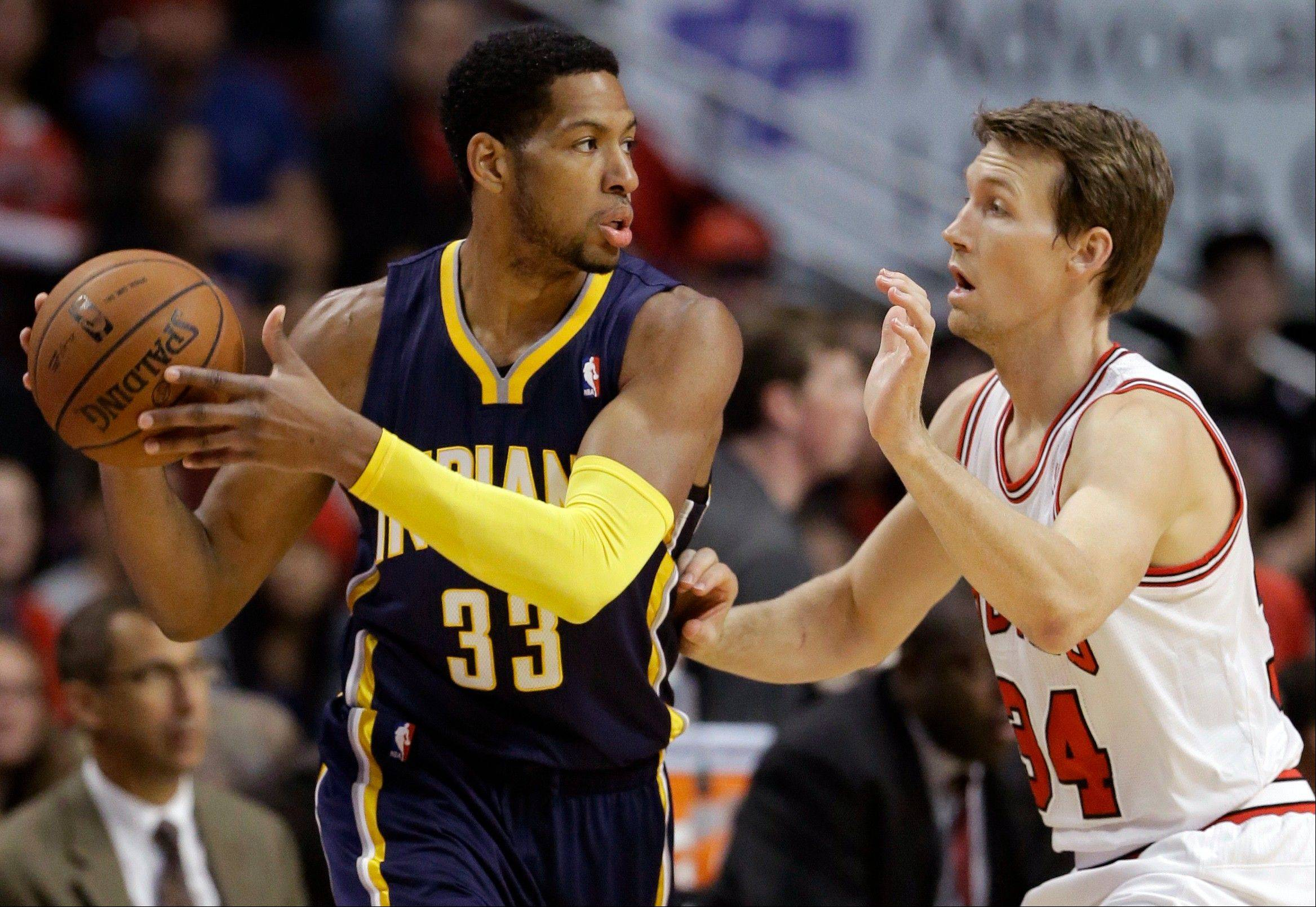 Indiana Pacers forward Danny Granger (33) looks to a pass as Chicago Bulls guard Mike Dunleavy (34) guards during the first half of an NBA preseason basketball game in Chicago on Friday, Oct. 18, 2013.