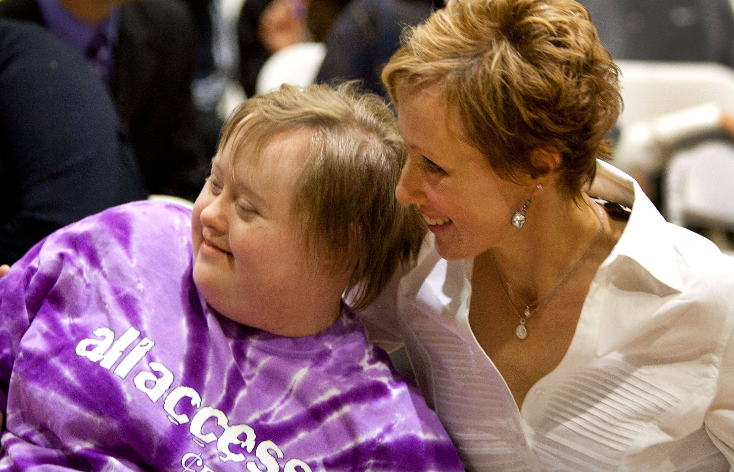 Daniel White/dwhite@dailyherald.com Homecoming queen Anne Wagner, who has Down syndrome relaxes with her mom Amy Wagner before an assembly at Downers Grove North High School.